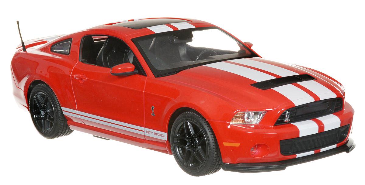 Rastar Радиоуправляемая модель Ford Shelby GT500 цвет красный49400_красныйРадиоуправляемая модель Rastar Ford Shelby GT500 предназначена для тех, кто любит роскошь и высокие скорости. Маневренная и реалистичная уменьшенная копия Ford Shelby GT500 выполнена в точной детализации с настоящим автомобилем в масштабе 1:14. Управление машиной происходит с помощью пульта. Машина двигается вперед и назад, поворачивает направо, налево и останавливается. Имеются световые эффекты. Колеса игрушки прорезинены и обеспечивают плавный ход, машина не портит напольное покрытие. Радиоуправляемые игрушки способствуют развитию координации движений, моторики и ловкости. Ваш ребенок часами будет играть с моделью, придумывая различные истории и устраивая соревнования. Порадуйте его таким замечательным подарком! Машина работает от 5 батареек напряжением 1,5V типа АА (не входят в комплект). Пульт управления работает от батарейки 9V типа Крона (не входит в комплект).