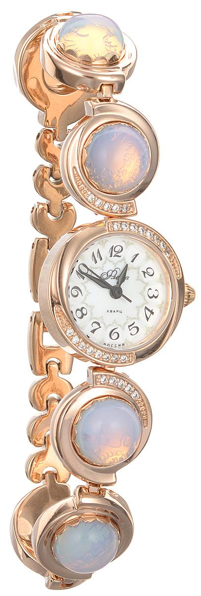 Часы женские наручные Mikhail Moskvin Флора, цвет: золотистый. 1138B8B1 Лунный камень матовый1138B8B1 Лунный камень матовыйЧасы Mikhail Moskvin серии Флора в ювелирном исполнении комплектуются натуральными камнями(Лунный камень).