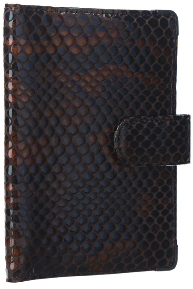 Обложка для документов женская Leo Ventoni, цвет: темно-коричневый, рыжий. L330222-06L330222-06 pitonСтильная обложка для документов Leo Ventoni выполнена из натуральной лаковой кожи, оформленной тиснением под рептилию, и дополнена металлической фурнитурой. Изделие раскладывается пополам и закрывается хлястиком на кнопку. Подкладка из полиэстера. Внутри размещены два боковых кармана для паспорта и четыре кармана для кредитных карт. Изделие поставляется в фирменной упаковке. Оригинальная обложка для документов Leo Ventoni станет отличным подарком для человека, ценящего качественные и практичные вещи.