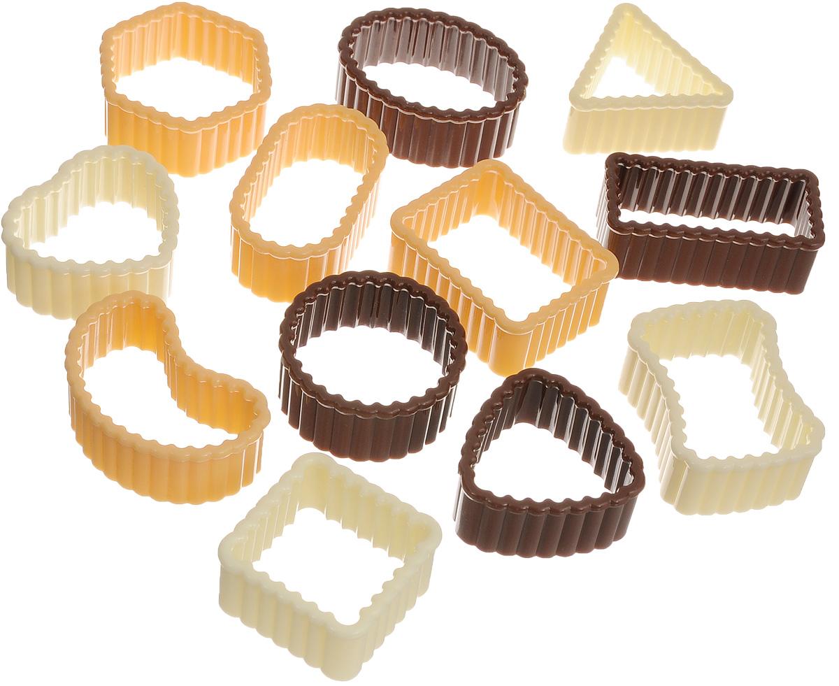 Формочки для печенья Tescoma Delicia, 12 штук630905Формочки для печенья Tescoma Delicia изготовлены из пластика. Предназначены для вырезания печенья. Можно использовать как трафареты для поделок и с непищевыми материалами. С такими формами- резаками можно сделать множество интересных фигурок и поделок. В набор входит пластиковое кольцо для удобного хранения формочек. Средний размер форм: 3,5 х 4 см. Высота стенки формы: 2 см. Диаметр кольца: 9,5 см.