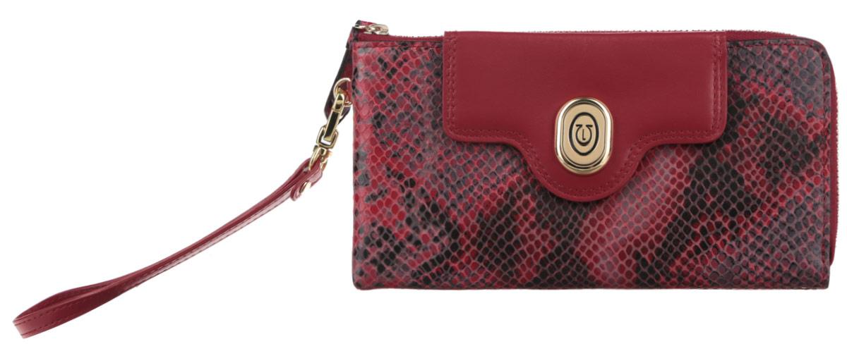 Кошелек женский Leo Ventoni, цвет: красный, черный. L330673L330673-rosso pitoneОригинальный женский кошелек Leo Ventoni выполнен из натуральной кожи с тиснением под змею и застегивается на металлическую застежку-молнию. Изделие содержит два отделения для купюр, разделенные между собой карманом-средником, два продольных боковых кармана, двенадцать кармашков для кредитных карт и визиток, а также один карман с прозрачным пластиковым окошком. На задней стенке расположен врезной карман на металлической молнии для монет. Кошелек декорирован клапаном с металлическим элементом, под клапаном дополнительные две прорези для кредитных карт. К кошельку прилагается съемная ручка на карабине для запястья. Изделие поставляется в фирменной коробке с логотипом бренда. Стильный кошелек Leo Ventoni станет отличным подарком для человека, ценящего качественные и практичные вещи.