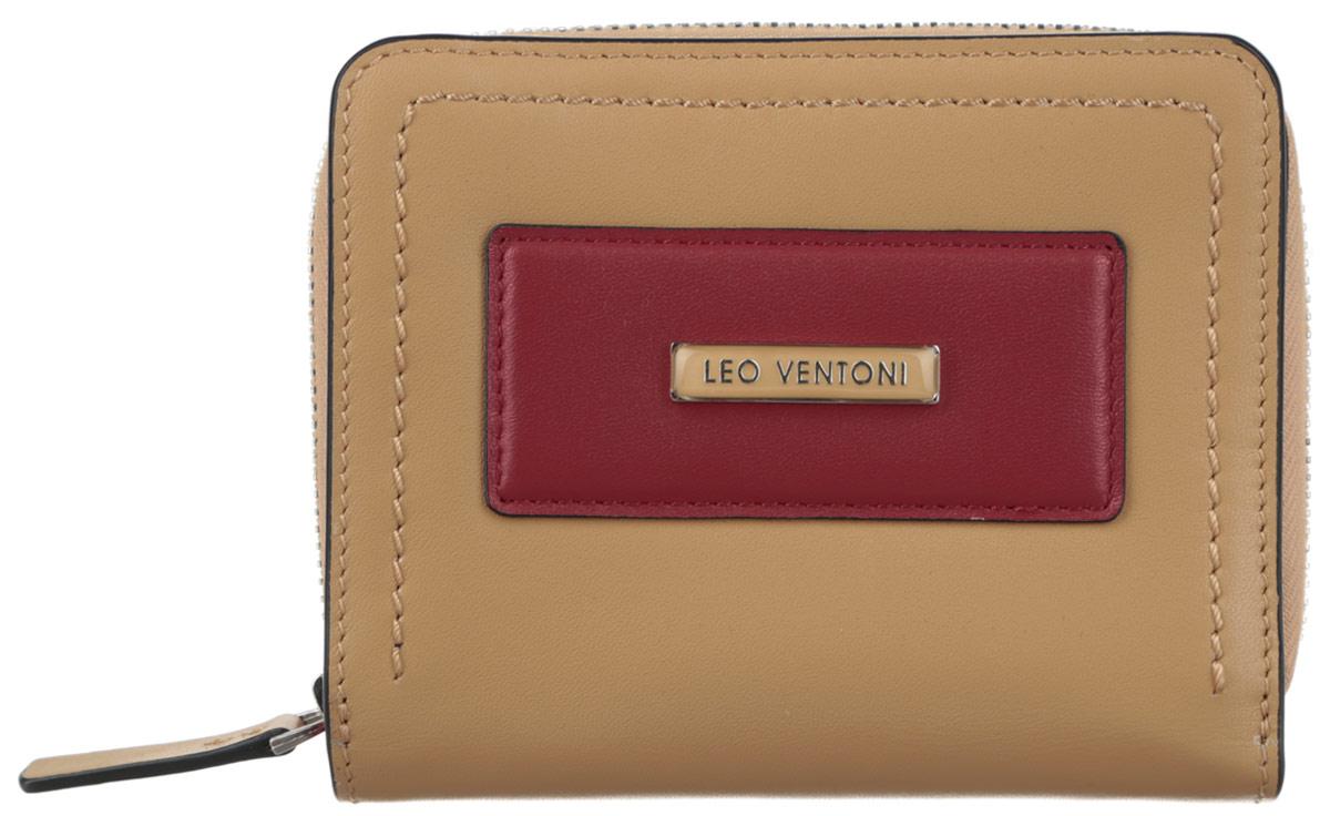 Кошелек женский Leo Ventoni, цвет: бежевый, темно-красный. L330797L330797 tan/nero/rossoОригинальный женский кошелек Leo Ventoni выполнен из натуральной кожи. Кошелек застёгивается на кнопку и содержит два кармана для купюр, три кармашка для визиток и кредитных карт, три дополнительных небольших кармана, а также карман с пластиковым окошком. На тыльной стороне расположен карман на металлической застёжке-молнии с двумя отделами для монет. Кошелек декорирован контрастной нашивкой с пластиной логотипа бренда. Изделие поставляется в фирменной коробке с логотипом бренда. Кошелек - это удобный и стильный аксессуар, необходимый любому активному человеку для хранения денежных купюр, визиток, пластиковых карт и других документов. Надежный кошелек Leo Ventoni сочетает в себе классический дизайн и функциональность, и является неотъемлемым элементом делового и повседневного стиля. Он не только практичен в использовании, но также позволит вам подчеркнуть свою индивидуальность.