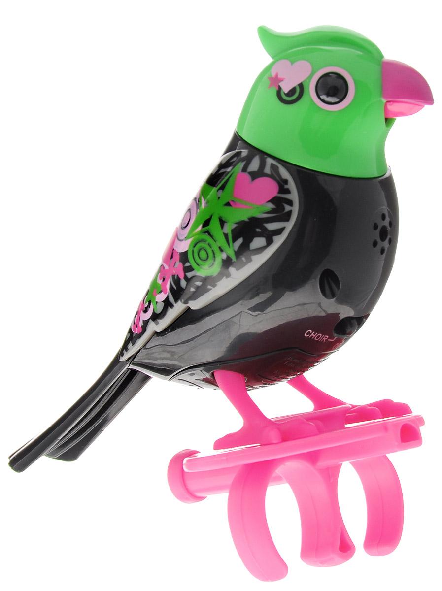DigiFriends Интерактивная игрушка Птичка с кольцом цвет черный зеленый розовый88286_черный,зеленый,розовыйУ вас есть шанс получить уникального домашнего питомца - поющую птичку. Не каждый может похвастаться этим. Эта умная птичка интерактивная, она будет развлекать вас различными мелодиями, пением и ритмичными движениями. Для активизации птички необходимо подуть на нее. Чтобы активировать режим проигрывания мелодий достаточно посвистеть в свисток, который имеется в комплекте. Игрушка издает 55 вариантов мелодий и звуков. Кольцо-свисток может служить как переносной насест для птички. Ребенок может надеть кольцо на два пальца, закрепить там игрушку и свободно играть или даже бегать. Птичка DigiFriends устойчива на любой ровной поверхности. Игрушка может поворачивать голову и шевелить клювом в такт мелодии. Игрушка работает в двух режимах: соло и хор. Можно синхронизировать неограниченное количество птичек или других персонажей DigiFriends. Главным в хоре становится персонаж, которого первого включили. Необходимо размещать DigiFriends на расстоянии не более 15 см от главной...