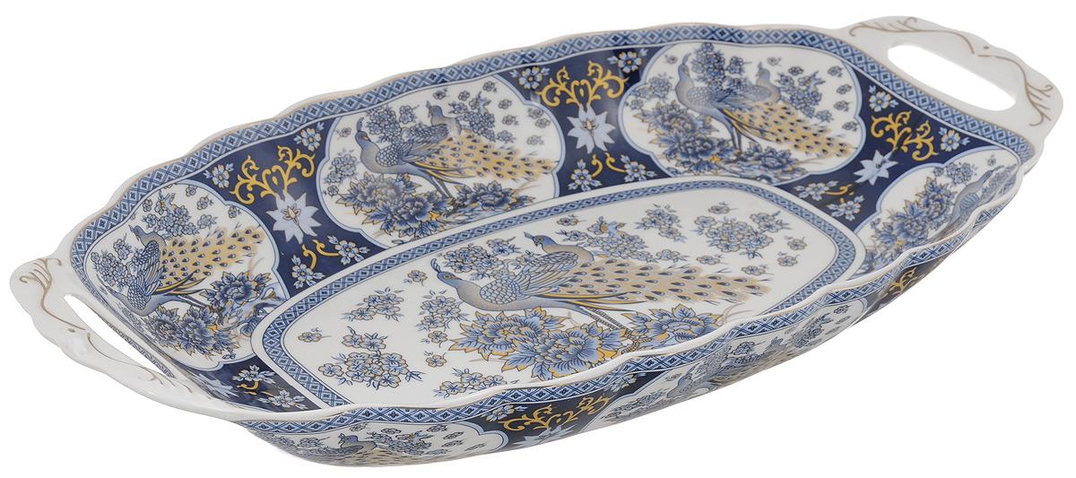 Блюдо для горячего Elan Gallery Синий павлин, 42,5 х 22 см740139Блюдо для горячего Elan Gallery Синий павлин, изготовленное из керамики, станет украшением вашего праздничного стола. Изделие подходит для подачи горячего или шашлыка. В такой посуде можно приготовить блюдо и, не перекладывая на другую тарелку, подать его стол. Благодаря двум ручками его удобно переносить. Красочность оформления придется по вкусу тем, кто предпочитает утонченность и изящность. Не рекомендуется применять абразивные моющие средства. Не использовать в микроволновой печи. Объем блюда: 1,5 л. Размер блюда (с учетом ручек): 42,5 х 22 х 6 см.