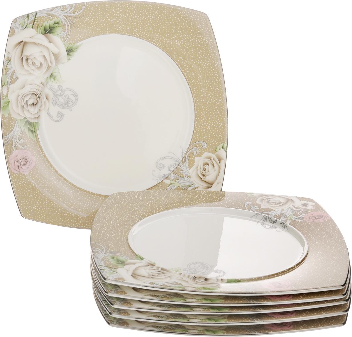 Набор тарелок Family & Friends Florance, 20 х 20 см, 6 штPR7990нНабор Family & Friends Florance, выполненный из фарфора, состоит из 6 плоских квадратных тарелок и предназначен для красивой сервировки различных блюд. Изделия украшены цветочным рисунком. Набор сочетает в себе стильный дизайн с максимальной функциональностью. Оригинальность оформления придется по вкусу и ценителям классики, и тем, кто предпочитает утонченность и изящность. Внутренний диаметр тарелки: 14 см. Размер тарелки: 20 х 20 х 1 см.