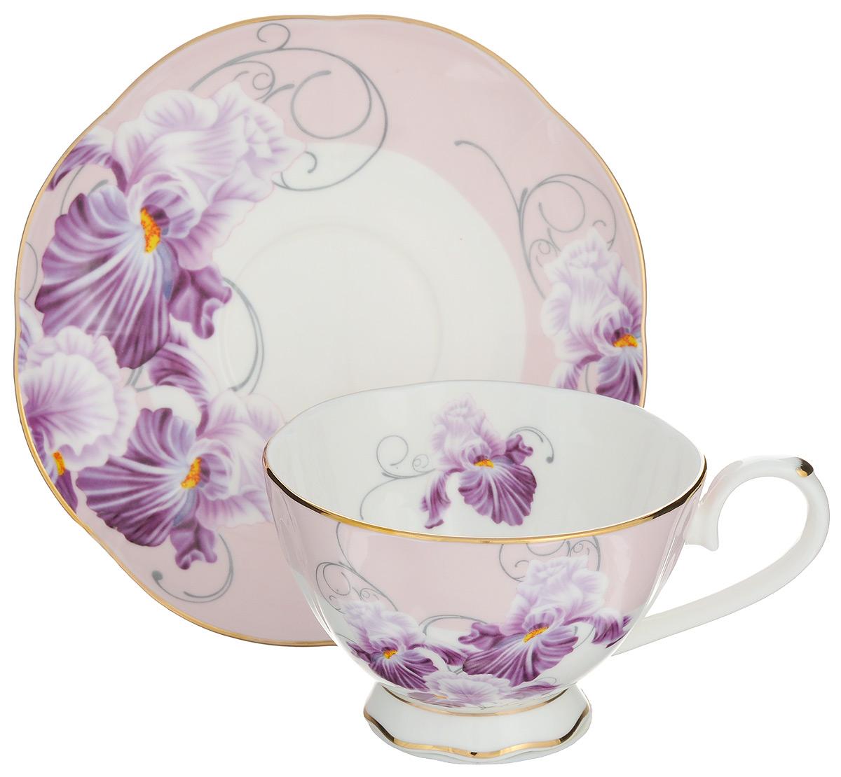 Чайная пара Elan Gallery Ирисы, 2 предмета530033Чайная пара Elan Gallery Ирисы состоит из чашки и блюдца, изготовленных из керамики высшего качества, отличающегося необыкновенной прочностью и небольшим весом. Яркий дизайн, несомненно, придется вам по вкусу. Чайная пара Elan Gallery Ирисы украсит ваш кухонный стол, а также станет замечательным подарком к любому празднику. Не рекомендуется применять абразивные моющие средства. Не использовать в микроволновой печи. Объем чашки: 230 мл. Диаметр чашки (по верхнему краю): 10 см. Высота чашки: 7 см. Диаметр блюдца (по верхнему краю): 16 см. Высота блюдца: 2 см.