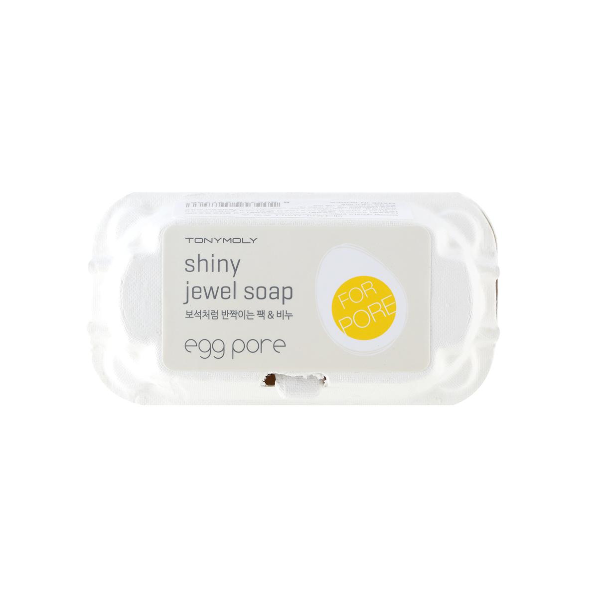 TonyMoly Мыло-маска для сияния кожи Egg pore Shiny Jewel Soap, 2 шт.ES01000300Мыло-маска Tony Moly Egg Pore Shiny Jewel Soap в форме яиц предназначено для утреннего и вечернего очищения кожи. Нежная пенка, которая получается в результате контакта мыла с водой, легко смывает с лица любые загрязнения. Благодаря экстракту яичного белка средство удаляет с поверхности кожи пыль, отшелушивает ороговевшие частицы кожи и очищает поры от скопившегося кожного жира. Мыльная пенка насыщает кожу полезными компонентами, разглаживает мелкие морщинки, подсушивает воспалительные процессы и успокаивает раздражения. Средство делает кожу гладкой и шелковистой, цвет лица - ровным и сияющим, а поры - чистыми и суженными.