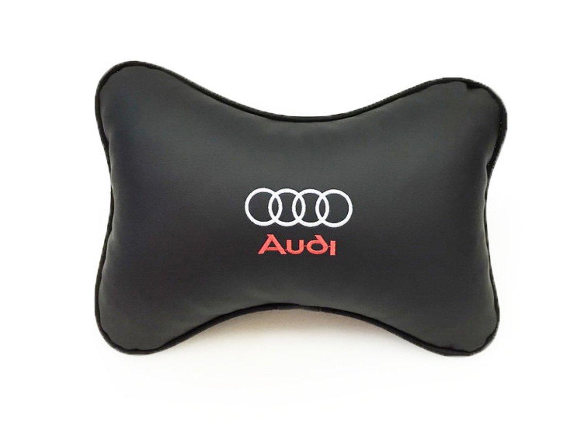Подушка на подголовник Auto premium AUDI, цвет: черный. 3700137001Подушка на подголовник-это прежде всего это лучший способ создать комфорт для шеи и головы во время пребывания в автомобильном кресле. Большинство штатных подголовников устроены так, что до них попросту не дотянуться. Данный аксессуар полность решает эту проблему, создавая мягкую ортопедическою поддержку. Подушка крепится к сиденью, а это значит один раз поставил - и забыл. Меньше утомляемость - а следовательно выше внимание и концентрация на дороге. Одинакова удобна для пассажира и водителя. Выполнена из эко-кожи, а значит имеет повышенный ресурс и прочность. Легко чистится влажной тряпкой, не требует стирки, не впитывает пыль и грязь. Экокожа дышащий материал, а значит будет комфортно и летом.
