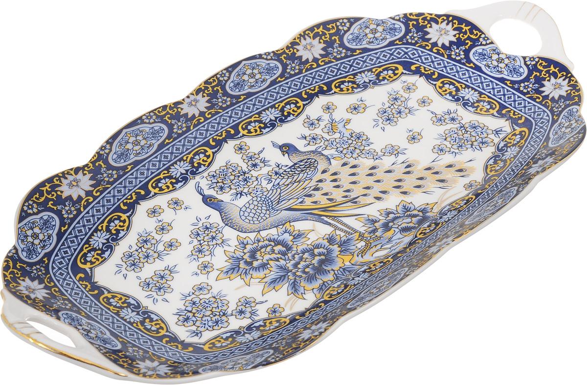 Блюдо для нарезки Elan Gallery Павлин, 30 х 15 см740157Блюдо для нарезки Elan Gallery Павлин, изготовленное из керамики, прекрасно подойдет для подачи нарезок, закусок и других блюд. Блюдо дополнено двумя удобными ручками и оформлено рисунком. Такое блюдо украсит сервировку вашего стола и подчеркнет прекрасный вкус хозяйки. Не рекомендуется применять абразивные моющие средства. Не использовать в микроволновой печи. Размер блюда по верхнему краю (с учетом ручек): 30 х 15 см.