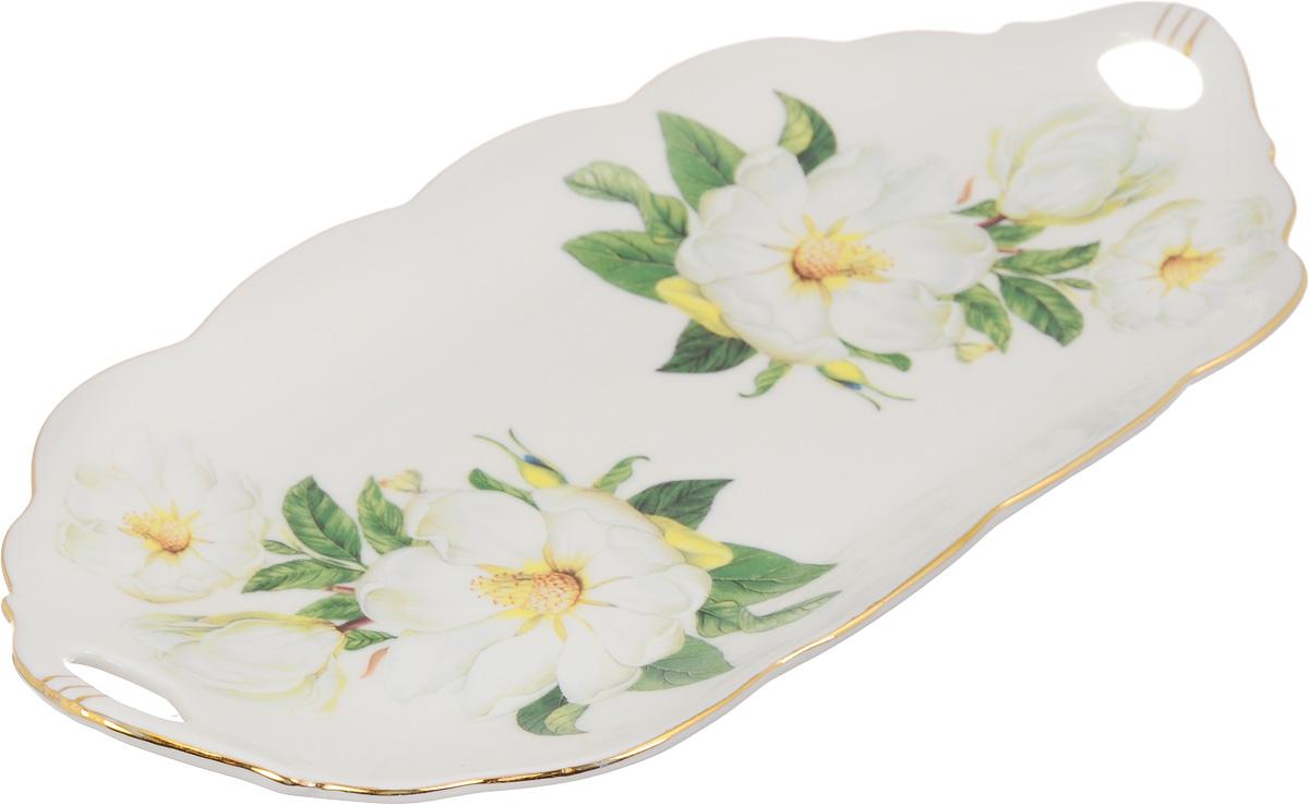 Блюдо для нарезки Elan Gallery Белый шиповник, 30 х 15 см740161Блюдо для нарезки Elan Gallery Белый шиповник, изготовленное из керамики, прекрасно подойдет для подачи нарезок, закусок и других блюд. Блюдо дополнено двумя удобными ручками и оформлено цветочным рисунком. Такое блюдо украсит сервировку вашего стола и подчеркнет прекрасный вкус хозяйки. Не рекомендуется применять абразивные моющие средства. Не использовать в микроволновой печи. Размер блюда по верхнему краю (с учетом ручек): 30 х 15 см.