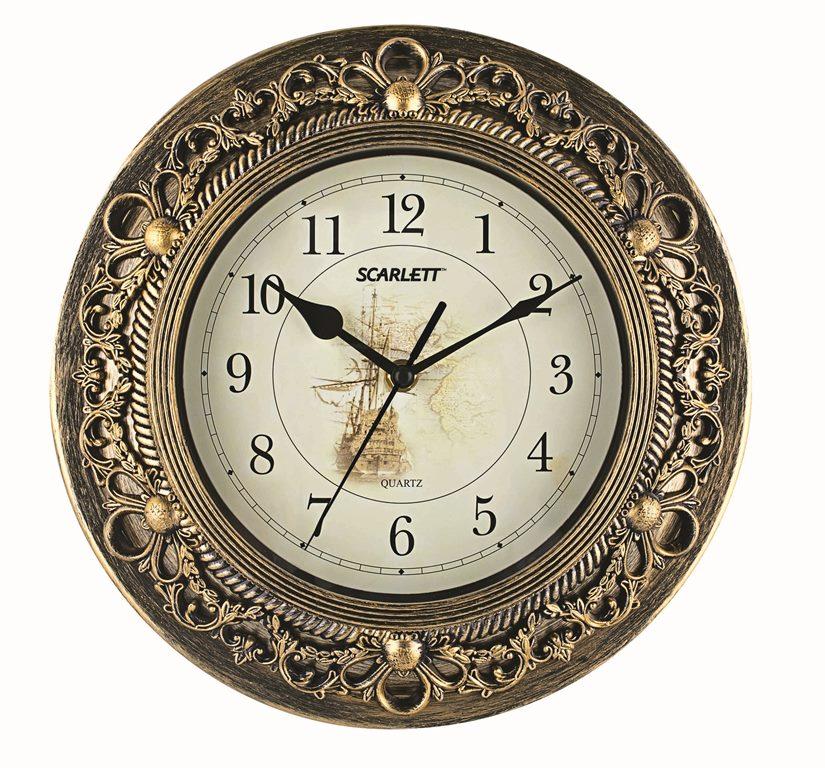 Часы настенные Scarlett, диаметр 30,5 см. SC - 27CSC - 27CНастенные кварцевые часы Scarlett в классическом дизайне, изготовленные из пластика, прекрасно впишутся в интерьер вашего дома. Круглые часы имеют три стрелки: часовую, минутную и секундную, циферблат защищен прозрачным пластиком. Часы работают от 1 батарейки типа АА напряжением 1,5 В (батарейка в комплект не входит). Диаметр часов: 30,5 см.