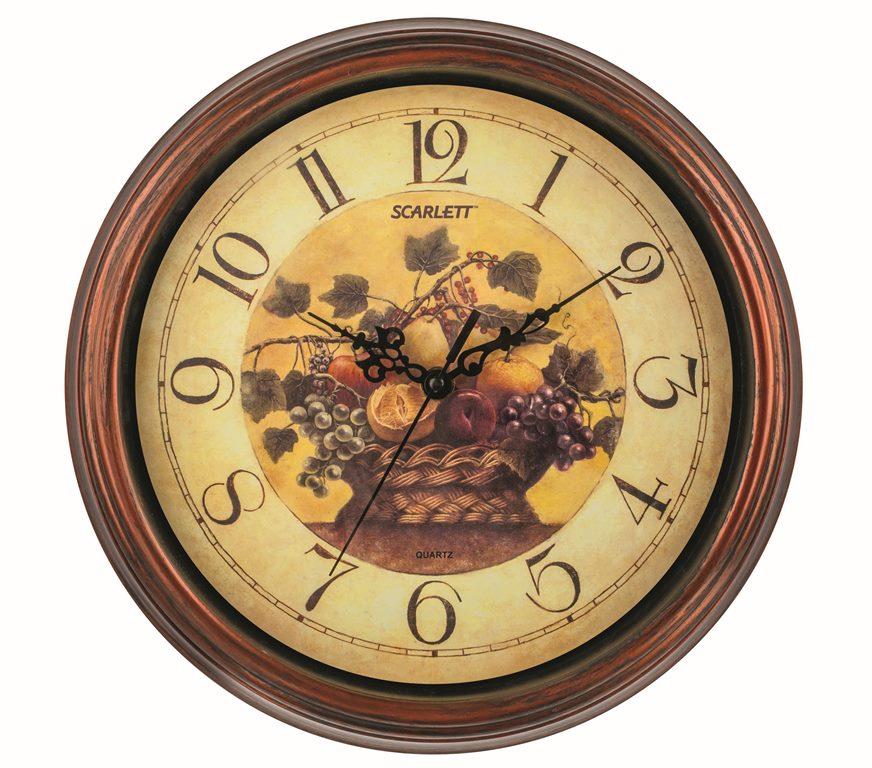 Часы настенные Scarlett, диаметр 30,5 см. SC - 25LSC - 25LНастенные кварцевые часы Scarlett, изготовленные из пластика, прекрасно впишутся в интерьер вашего дома. Круглые часы имеют три стрелки: часовую, минутную и секундную, циферблат защищен прозрачным пластиком. Часы работают от 1 батарейки типа АА напряжением 1,5 В (батарейка в комплект не входит). Часы бренда Scarlett - это надежность, качество и изящность стиля во все времена. Диаметр часов: 30,5 см.