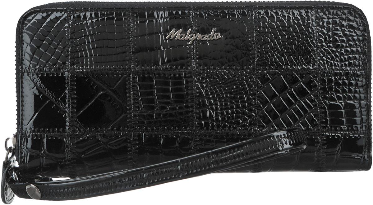 Кошелек женский Malgrado, цвет: черный. 73005-239A73005-239A BlackСтильный клатч Malgrado изготовлен из натуральной кожи черного цвета с декоративным тиснением и закрывается на молнию. Внутри расположены четыре основных отделения, одно из которых на молнии, по четыре кармашка на боковых стенках для карточек, визиток, кредиток и два кармашка побольше, в которые можно положить пропуск, проездной билет или фотографию. В комплект так же входит кожаный ремешок для удобной переноски. Клатч упакован в металлическую коробку с логотипом фирмы. Такой кошелек станет замечательным подарком человеку, ценящему качественные и практичные вещи.