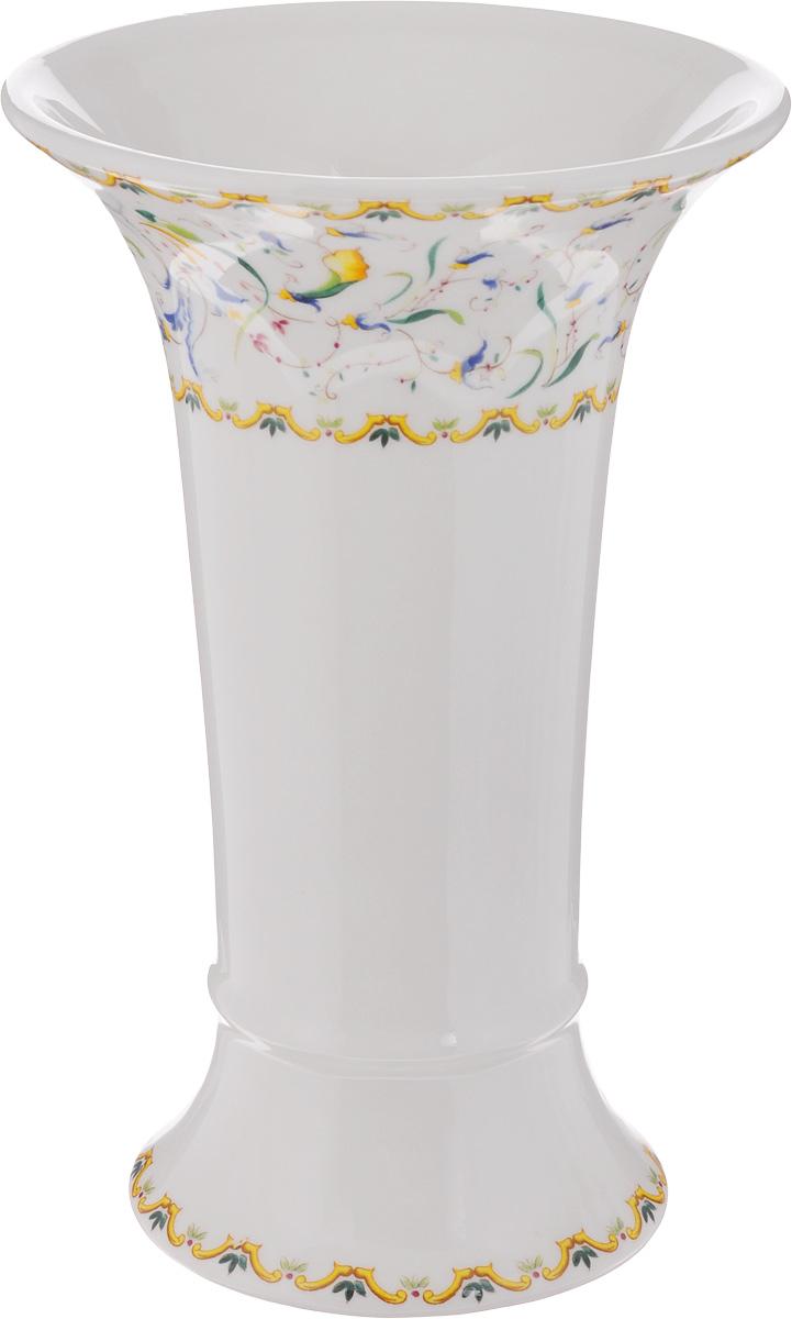 Ваза для цветов Imari Шампань, высота 21,5 смIM65078-A2055ALЭлегантная ваза Imari Шампань выполнена из высококачественной керамики и оформлена ярким узором. Она придется по вкусу и ценителям классики, и тем, кто предпочитает утонченность и изящность. Вы можете поставить вазу в любом месте, где она будет удачно смотреться, и радовать глаз. Такая ваза подойдет и для цветов, и для декора интерьера. Кроме того - это отличный вариант подарка для ваших близких и друзей. Высота вазы: 21,5 см. Диаметр вазы по верхнему краю: 14 см. Диаметр основания вазы: 10 см.