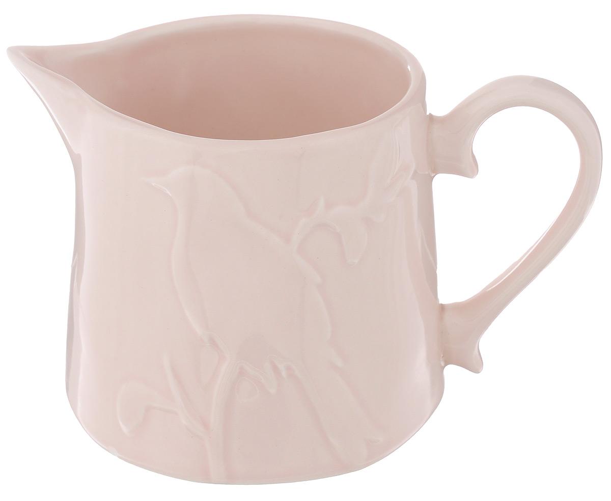 Молочник SantaFe Птицы, цвет: розовый, 500 млSL-SA14233p-ALМолочник SantaFe Птицы изготовлен из высококачественной керамики, покрытой сверкающей глазурью. Изделие декорировано изысканным рельефом в виде птицы, сидящей на ветке. Молочник имеет широкое основание, удобную ручку и носик. Предназначен для сливок и молока. Такой молочник станет изысканным украшением стола к чаепитию и подчеркнет ваш безупречный вкус. Изделие также станет хорошим подарком к любому случаю. Можно использовать в СВЧ и мыть в посудомоечной машине. Диаметр (по верхнему краю): 8,5 см. Диаметр основания: 10 см. Высота молочника: 9 см.