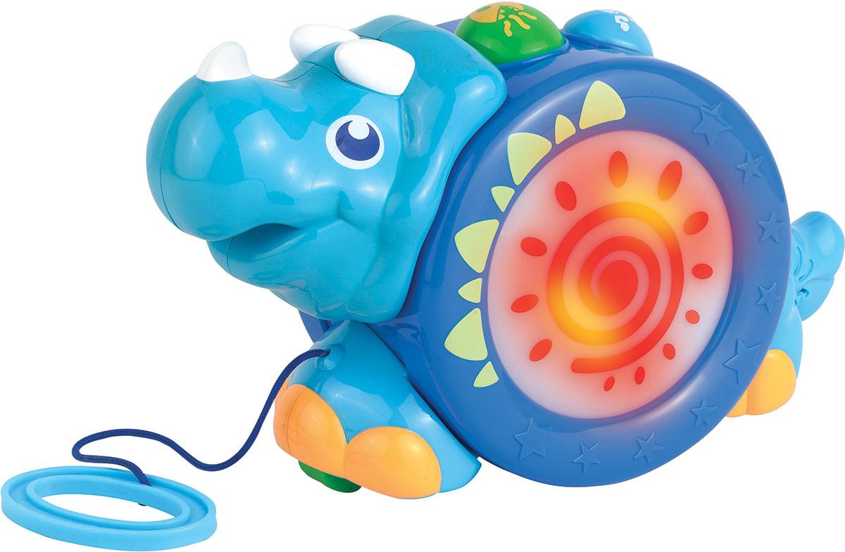 Happy Kid Игрушка-каталка Носорог4206TКаталка-носорог для длительных и увлекательных прогулок Игрушка-каталка на шнурке (носорог) отлично поднимет настроение малышу на прогулке. Она привлекает внимание своим ярким образом, мелодичной музыкой и подсветкой. Носорог окрашен в синий и голубой цвет и украшен разноцветными рисунками, кнопочками и шипами. В ножках носорога спрятаны колесики, которые позволяют легко катиться по ровной поверхности – по полу или по асфальту. К каталке прикреплена веревка с пластмассовым колечком, за которое удобно держаться и вести ее. Носорога можно катать за веревочку и просто рукой, а если нажать на кнопочку, то заиграет музыка, и носорог засветится. Игрушка не только является развлечением для малышей, но и развивает их способности. Ощупывая носорога, малыш будет развивать свою тактильную чувствительность, мелкую и крупную моторику и координацию движений. Игровые наборы со световыми и звуковыми эффектами отлично развивают у детей зрение и слух, а так же занимают их на длительное время.
