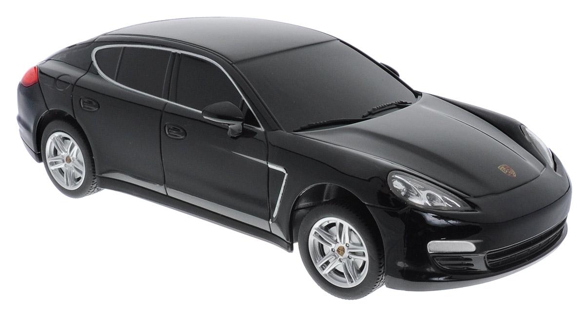 Rastar Радиоуправляемая модель Porsche Panamera цвет черный масштаб 1:2446200_черныйРадиоуправляемая модель Rastar Porsche Panamera станет отличным подарком любому мальчику! Все дети хотят иметь в наборе своих игрушек ослепительные, невероятные и крутые автомобили на радиоуправлении. Тем более, если это автомобиль известной марки с проработкой всех деталей, удивляющий приятным качеством и видом. Одной из таких моделей является автомобиль на радиоуправлении Rastar Porsche Panamera. Это точная копия настоящего авто в масштабе 1:24. Возможные движения: вперед, назад, вправо, влево, остановка. Имеются световые эффекты. Пульт управления работает на частоте 27 MHz. Для работы игрушки необходимы 3 батарейки типа АА (не входят в комплект). Для работы пульта управления необходимы 2 батарейки типа АА (не входят в комплект).