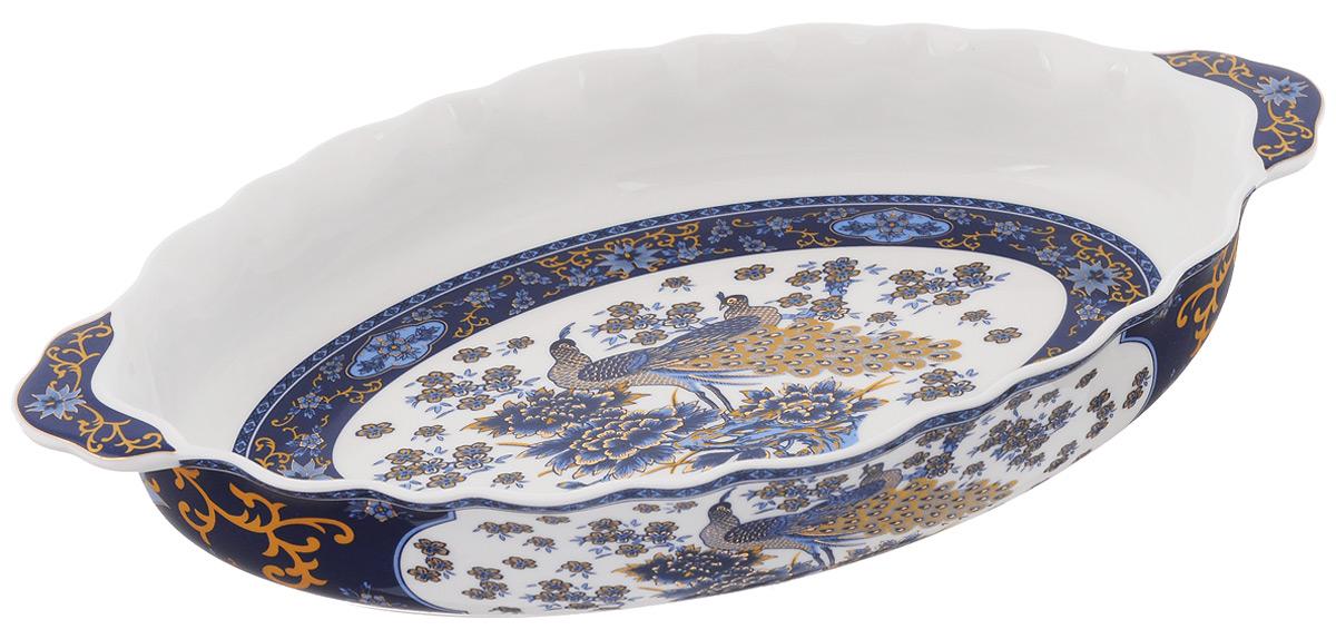 Блюдо Elan Gallery Павлин синий, 30 х 17,5 см503694Сервировочное блюдо Elan Gallery Павлин синий, изготовленное из керамики, идеально подойдет для подачи горячего, приготовления и хранения слоеных салатов, для заливного или холодца. Оно станет отличным дополнением к вашему кухонному инвентарю и подчеркнет прекрасный вкус хозяйки. Не рекомендуется применять абразивные моющие средства. Не использовать в микроволновой печи. Размер блюда (по верхнему краю): 30 х 17,5 см.