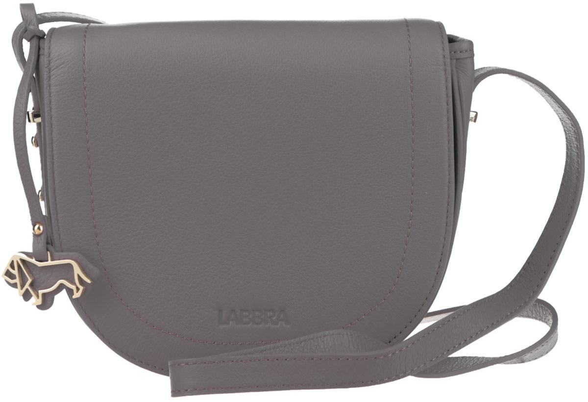 Сумка женская Labbra, цвет: светло-серый. L-FB303L-FB303Стильная женская сумка Labbra выполнена из натуральной кожи с зернистой фактурой, оформлена символикой бренда и декоративной подвеской. Изделие содержит одно вместительное отделение, закрывающееся на застежку-молнию и дополнительно клапаном на магнитную кнопку. Внутри сумки расположены накладной кармашек для мелочей и врезной карман на застежке-молнии. Задняя сторона сумки дополнена врезным карманом на молнии. Изделие оснащено практичным плечевым ремнем регулируемой длины. Оригинальный аксессуар позволит вам завершить образ и быть неотразимой.