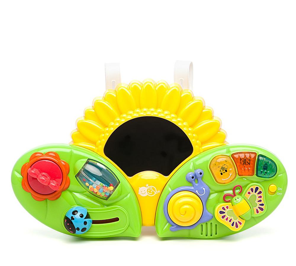 Playgo Развивающий центр Подсолнух на кроваткуPlay 2458Playgo развивающая игрушка со световыми и звуковыми эффектами Подсолнух, несомненно, придется по душе вашему ребенку! Игрушка от бельгийской компании Playgo - это настоящий развивающий центр для самых маленьких! При помощи удобных креплений игровая панель фиксируется к бортам детской кроватки. Когда малыш подрастет, то сможет самостоятельно пользоваться игрушкой сидя. В центре панели расположено большое безопасное зеркальце. В левой части: божья коровка со звуком передвигается по специальному пазу, разноцветные бусинки в цилиндре перекатываются и шумят, красный цветочек крутится и трещит. Правая часть оснащена кнопками со звуковыми эффектами: домик улитки и каждая из трех ярких кнопочек включает свою мелодию. У забавной бабочки малыш может поворачивать яркое крылышко. Игрушка развивает мышление, воображение, зрительное и слуховое восприятия, мелкую моторику рук. Для работы требуются 3 батарейки типа АА (комплектуется демонстрационными).