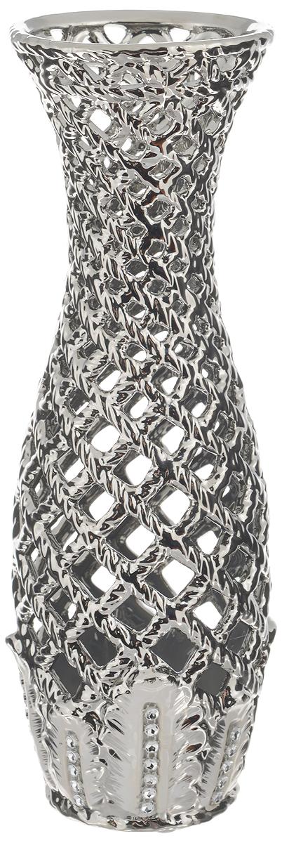 Ваза Sima-land Серебряная сетка, высота 28,5 см866198Ажурная ваза Sima-land Серебряная сетка, изготовленная из высококачественной керамики, добавит в интерьер морозный лоск и деликатный шик. Дно изделия оснащено нескользящими накладками. В такой вазе эффектно будут смотреться композиции, выполненные из декоративных цветов. Любое помещение выглядит незавершенным без правильно расположенных предметов интерьера. Они помогают создать уют, расставить акценты, подчеркнуть достоинства или скрыть недостатки.