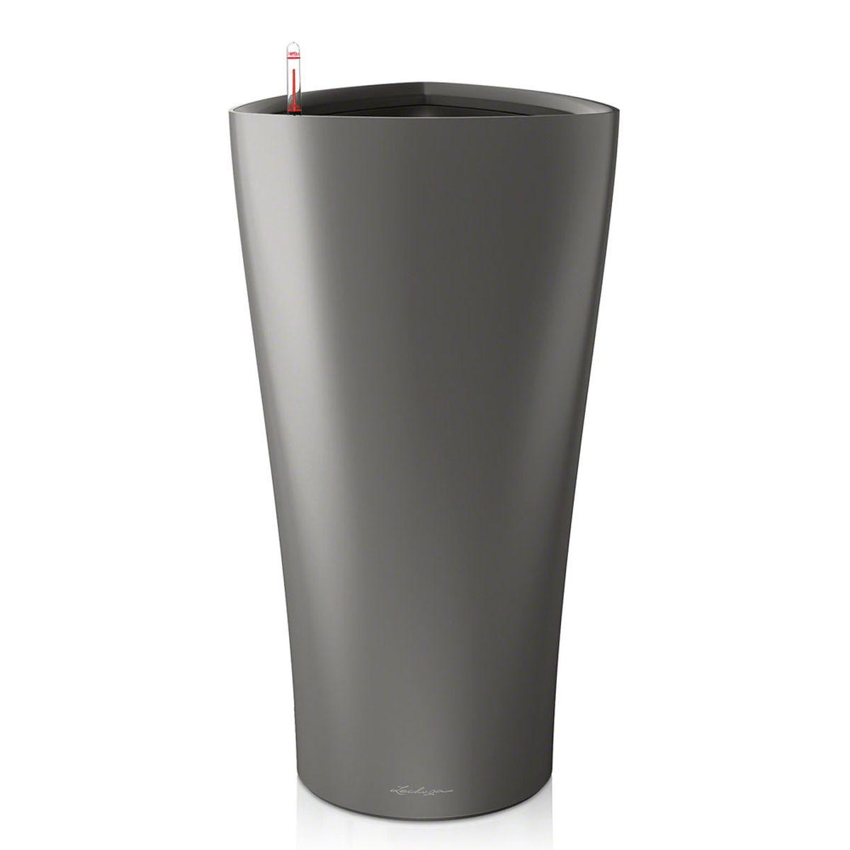 Кашпо Lechuza Delta, с системой автополива, цвет: антрацит, 40 х 40 х 75 см15543Кашпо Lechuza Delta, выполненное из высококачественного пластика, имеет уникальную систему автополива, благодаря которой корневая система растения непрерывно снабжается влагой из резервуара. Уровень воды в резервуаре контролируется с помощью специального индикатора. В зависимости от размера кашпо и растения воды хватает на 2-12 недель. Это способствует хорошему росту цветов и предотвращает переувлажнение. В набор входит: кашпо, внутренний горшок, индикатор уровня воды, резервуар для воды. Внутренний горшок, оснащенный выдвижными ручками, обеспечивает: - легкую переноску даже высоких растений; - легкую смену растений; - можно также просто убрать растения на зиму; - винт в днище позволяет стечь излишней дождевой воде наружу. Кашпо Lechuza Delta прекрасно впишется в интерьер больших холлов, террас ресторанов и уютных гостиных. Изделие поможет расставить нужные акценты и придаст помещению вид, соответствующий вашим...