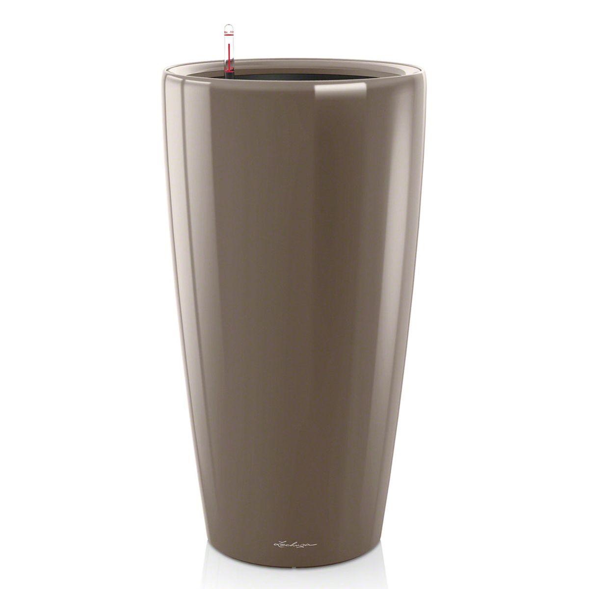 Кашпо с автополивом Lechuza Rondo 40х75 см, серо-коричневое15744Изящная форма кашпо RONDO является одновременно элегантной и несложной, и позволяет представить в выгодном свете любое растение. Сочетание кашпо с моделями CLASSICO идеально дополняет общую картину. Особые преимущества: - Всегда элегантный дизайн кашпо, соответствующий серии CLASSICO - Совершенная форма кашпо, для самых разных растений и позиций Внутренний горшок с выдвижными ручками обеспечивает: - Легкую переноску даже высоких растений - Легкую смену растений
