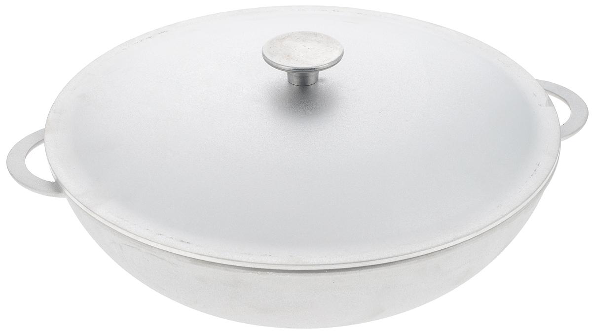 Сковорода-вок Биол с крышкой. Диаметр 32 см3203КСковорода-вок Биол изготовлена из литого алюминия. Изделие оснащено плотно прилегающей крышкой, позволяющей сохранить аромат готовящегося блюда. Сковорода снабжена двумя эргономичными ручками. Нельзя оставлять приготовленную пищу в посуде для хранения. Сковороду можно использовать на газовых, электрических и стеклокерамических плитах. Рекомендовано мыть вручную. Высота стенки: 10 см. Диаметр (по верхнему краю): 32 см. Ширина (с учетом ручек): 38 см.