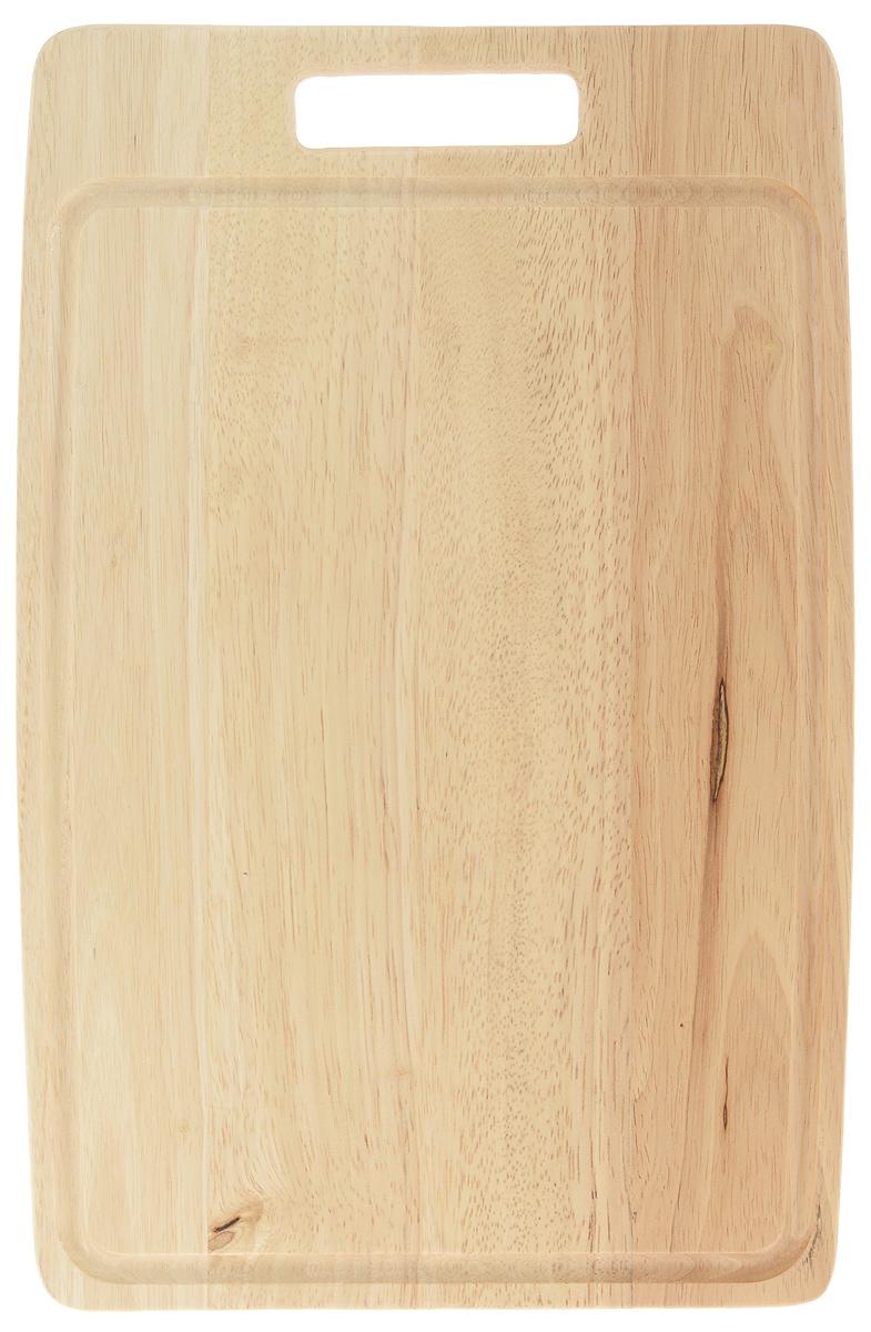 Доска разделочная Tescoma Woody, 40 x 26 см379616Прямоугольная разделочная доска Tescoma Woody изготовлена из высококачественной древесины - бразильского каучука. Изделие имеет массивный дизайн и оснащено желобом для жидкости. Ручка позволяет повесить доску в удобном для вас месте Функциональная и простая в использовании, разделочная доска Tescoma Woody прекрасно впишется в интерьер любой кухни. Не рекомендуется мыть в посудомоечной машине. Размер доски: 40 х 26 см. Толщина доски: 1,5 см.