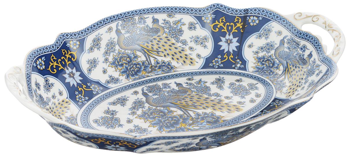 Блюдо Elan Gallery Синий павлин, 28 х 19 см740151Сервировочное блюдо Elan Gallery Синий павлин, изготовленное из керамики, идеально подойдет для подачи горячего, приготовления и хранения слоеных салатов, для заливного или холодца. Оно станет отличным дополнением к вашему кухонному инвентарю и подчеркнет прекрасный вкус хозяйки. Не рекомендуется применять абразивные моющие средства. Не использовать в микроволновой печи. Размер блюда (по верхнему краю): 28 х 19 см.