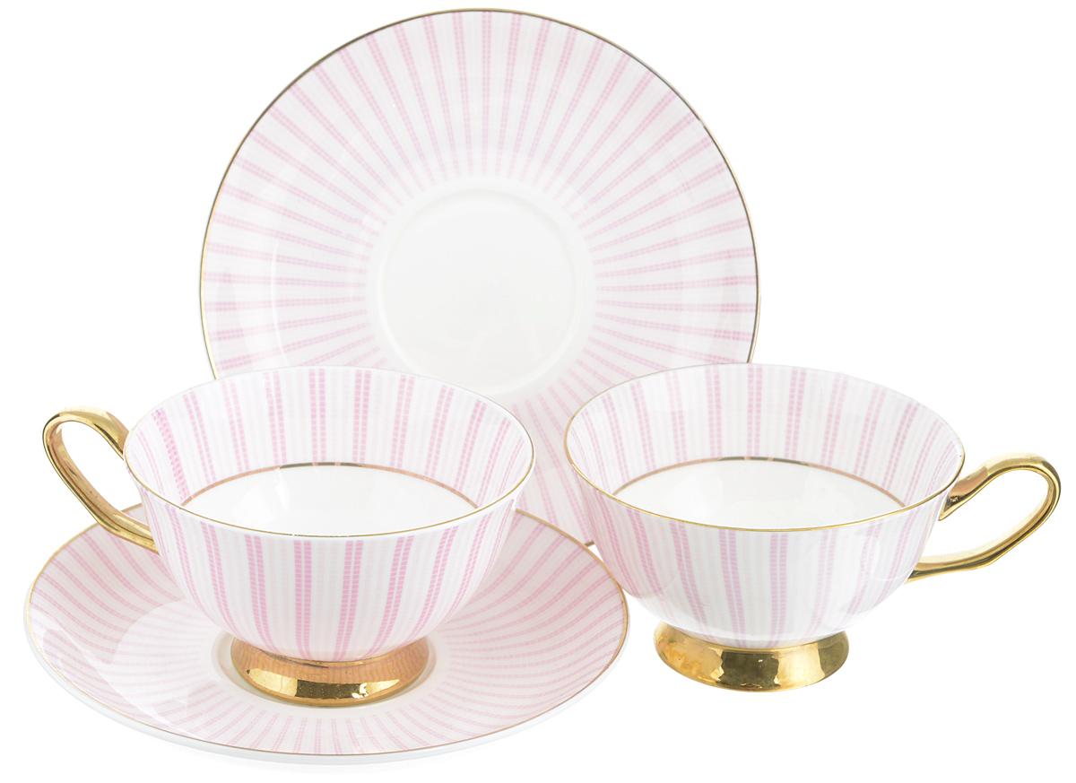 Набор чайный Elan Gallery Полоска, цвет: белый, розовый, 4 предмета470703Чайный набор Elan Gallery Полоска состоит из 2 чашек и 2 блюдец. Изделия, выполненные из высококачественного фарфора, имеют элегантный дизайн и классическую круглую форму. Такой набор прекрасно подойдет как для повседневного использования, так и для праздников. Чайный набор Elan Gallery Полоска - это не только яркий и полезный подарок для родных и близких, это также великолепное дизайнерское решение для вашей кухни или столовой. Не использовать в микроволновой печи. Объем чашки: 230 мл. Диаметр чашки (по верхнему краю): 10 см. Высота чашки: 6 см. Диаметр блюдца (по верхнему краю): 15 см. Высота блюдца: 2 см.