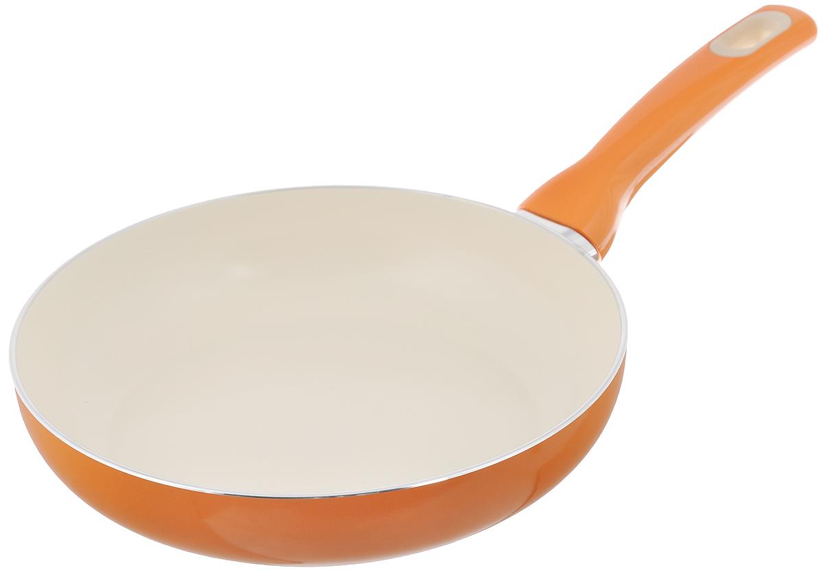 Сковорода Tescoma Fusion, с керамическим покрытием, цвет: оранжевый. Диаметр 24 см602824_оранжевыйСковорода Tescoma Fusion изготовлена из нержавеющей стали с высококачественным антипригарным керамическим покрытием. Керамика не содержит вредных примесей ПФОК, что способствует здоровому и экологичному приготовлению пищи. Кроме того, с таким покрытием пища не пригорает и не прилипает к стенкам, поэтому можно готовить с минимальным добавлением масла и жиров. Гладкая, идеально ровная поверхность сковороды легко чистится, ее можно мыть в воде руками или вытирать полотенцем. Эргономичная ручка специального дизайна выполнена из цветного пластика, удобна в эксплуатации. Можно мыть в посудомоечной машине. Сковорода подходит для использования на газовых, электрических, стеклокерамических и индукционных плитах. Диаметр: 24 см. Высота стенки: 5,5 см. Длина ручки: 18 см.