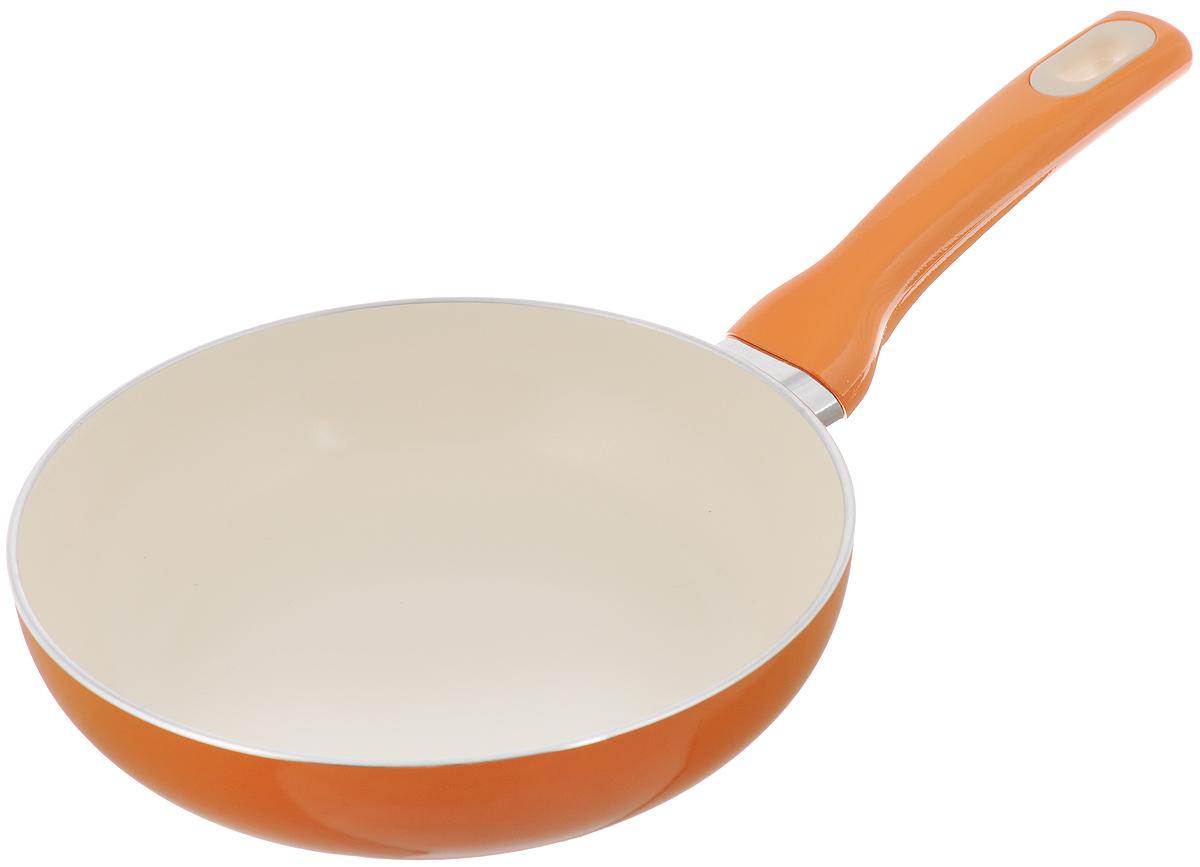 Сковорода Tescoma Fusion, с керамическим покрытием, цвет: оранжевый. Диаметр 20 см602820_оранжевыйСковорода Tescoma Fusion изготовлена из нержавеющей стали с высококачественным антипригарным керамическим покрытием. Керамика не содержит вредных примесей ПФОК, что способствует здоровому и экологичному приготовлению пищи. Кроме того, с таким покрытием пища не пригорает и не прилипает к стенкам, поэтому можно готовить с минимальным добавлением масла и жиров. Гладкая, идеально ровная поверхность сковороды легко чистится, ее можно мыть в воде руками или вытирать полотенцем. Эргономичная ручка специального дизайна выполнена из цветного пластика, удобна в эксплуатации. Можно мыть в посудомоечной машине. Сковорода подходит для использования на газовых, электрических, стеклокерамических и индукционных плитах. Диаметр: 20 см. Высота стенки: 5 см. Длина ручки: 16 см.