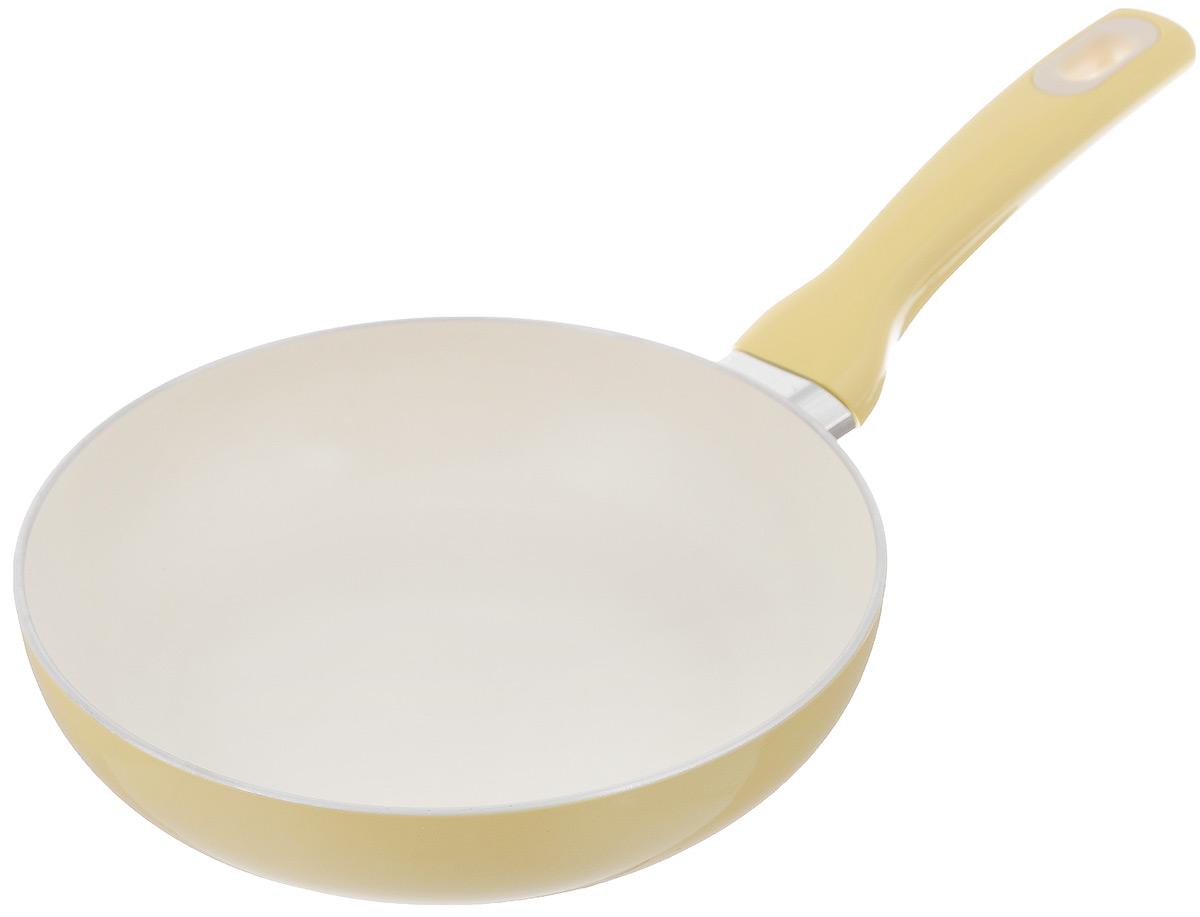 Сковорода Tescoma Fusion, с керамическим покрытием, цвет: светло-желтый. Диаметр 20 см602820_желтыйСковорода Tescoma Fusion изготовлена из нержавеющей стали с высококачественным антипригарным керамическим покрытием. Керамика не содержит вредных примесей ПФОК, что способствует здоровому и экологичному приготовлению пищи. Кроме того, с таким покрытием пища не пригорает и не прилипает к стенкам, поэтому можно готовить с минимальным добавлением масла и жиров. Гладкая, идеально ровная поверхность сковороды легко чистится, ее можно мыть в воде руками или вытирать полотенцем. Эргономичная ручка специального дизайна выполнена из цветного пластика, удобна в эксплуатации. Можно мыть в посудомоечной машине. Сковорода подходит для использования на газовых, электрических, стеклокерамических и индукционных плитах. Диаметр: 20 см. Высота стенки: 5 см. Длина ручки: 16 см.