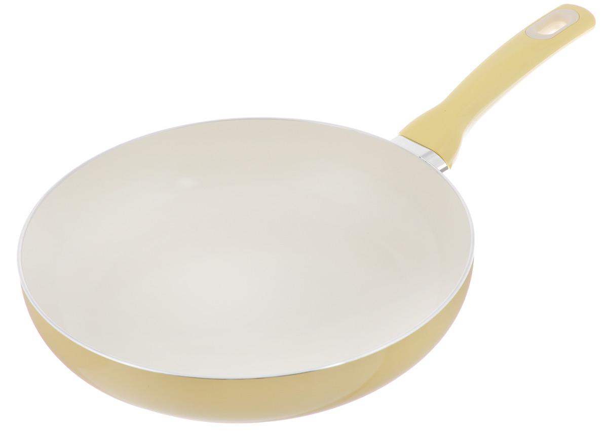 Сковорода Tescoma Fusion, с керамическим покрытием, цвет: желтый. Диаметр 26 см602826_желтыйСковорода Tescoma Fusion изготовлена из нержавеющей стали с высококачественным антипригарным керамическим покрытием. Керамика не содержит вредных примесей ПФОК, что способствует здоровому и экологичному приготовлению пищи. Кроме того, с таким покрытием пища не пригорает и не прилипает к стенкам, поэтому можно готовить с минимальным добавлением масла и жиров. Гладкая, идеально ровная поверхность сковороды легко чистится, ее можно мыть в воде руками или вытирать полотенцем. Эргономичная ручка специального дизайна выполнена из цветного пластика, удобна в эксплуатации. Можно мыть в посудомоечной машине. Сковорода подходит для использования на газовых, электрических, стеклокерамических и индукционных плитах. Диаметр: 26 см. Высота стенки: 6 см. Длина ручки: 19 см.