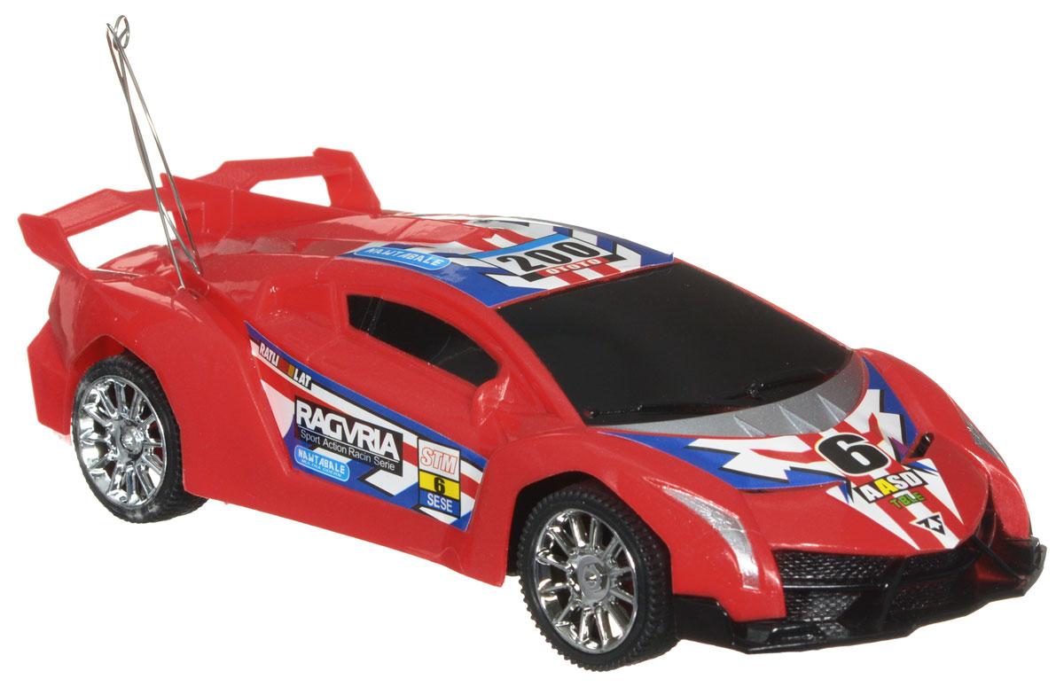 Plastic Toy Машина на радиоуправлении Ragvria цвет красныйB1335615_красныйМашина на радиоуправлении Plastic Toy Ragvria станет отличным подарком любому мальчику! Все дети хотят иметь в наборе своих игрушек ослепительные, невероятные и крутые автомобили на радиоуправлении. Управление машинкой происходит с помощью пульта. Моделью легко управлять и любая гонка принесет удовольствие. Автомобиль двигается вперед и назад, поворачивает направо и налево, останавливается. Машина выполнена из пластика с металлическими элементами. Колеса игрушки прорезинены и обеспечивают плавный ход, машинка не портит напольное покрытие. Радиоуправляемые игрушки способствуют развитию координации движений, моторики и ловкости. Ваш ребенок часами будет играть с моделью, придумывая различные истории и устраивая соревнования. Машина работает от 3 батареек типа АА (не входят в комплект). Для работы пульта управления необходимы 2 батарейки типа AA (не входит в комплект).