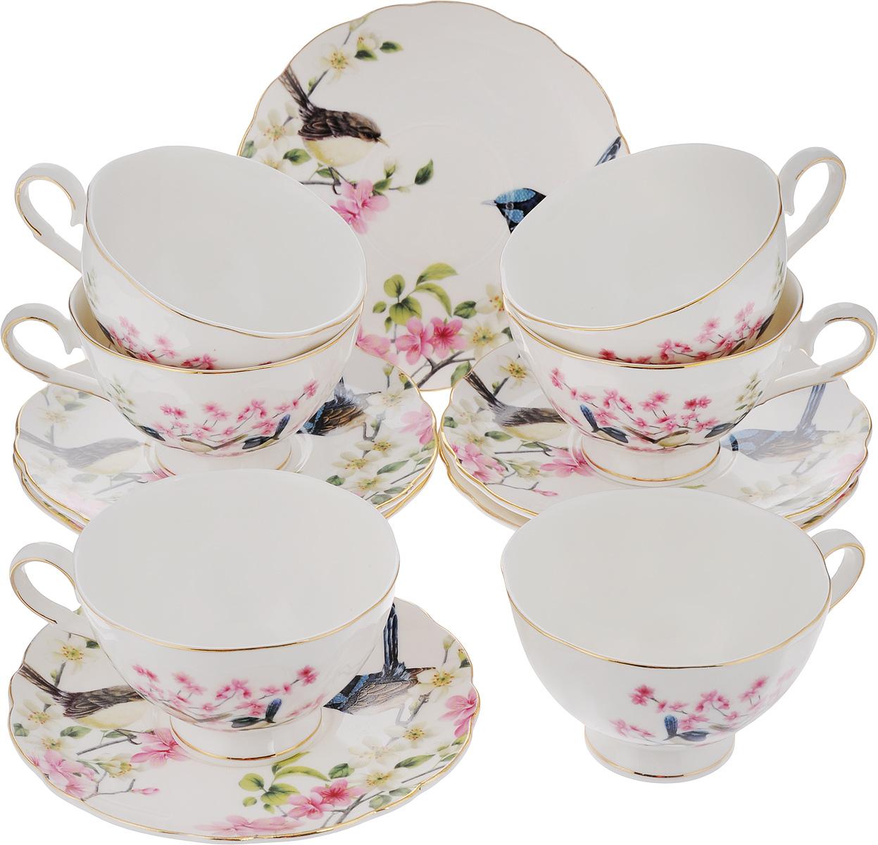 Набор чайный Elan Gallery Райские птички, 12 предметов420025Чайный набор Elan Gallery Райские птички состоит из 6 чашек и 6 блюдец. Изделия, выполненные из высококачественной керамики, имеют элегантный дизайн и классическую круглую форму. Такой набор прекрасно подойдет как для повседневного использования, так и для праздников. Чайный набор Elan Gallery Райские птички - это не только яркий и полезный подарок для родных и близких, а также великолепное дизайнерское решение для вашей кухни или столовой. Не использовать в микроволновой печи. Объем чашки: 220 мл. Диаметр чашки (по верхнему краю): 10 см. Высота чашки: 6,5 см. Диаметр блюдца (по верхнему краю): 15 см. Высота блюдца: 1,5 см.