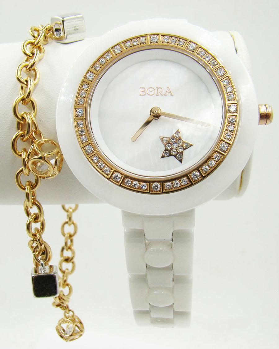 Керамические часы с браслетом TAYA T-B-6757-WATCH-GL.WHITET-B-6757-WATCH-GL.WHITEЧасы наручные электронно-механические кварцевые. Характеристики: часы аксессуарные, с механической индикацией. Часовой механизм Seiko Instruments (SII), Япония с питанием от сменного кварцевого элемента питания типа SR626SW. Часы: Крышка из нержавеющей стали; корпус: керамика; браслет: керамика, сталь. Стекло. Стразы. Браслет: Бижутерный сплав (не содержит свинец), цирконы, золотое покрытие (18 карат)