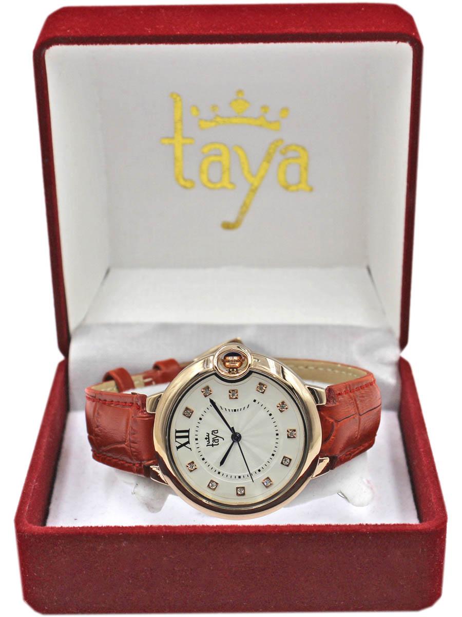 Часы TAYA T-W-0005-WATCH-GL.REDT-W-0005-WATCH-GL.REDСтильные часы с золотым циферблатом, стразами внутри, темно-синими перламутровыми стрелками. заводной механизма утоплен в прорезь в циферблате. Часы наручные электронно-механические кварцевые, аксессуарные, с механической индикацией. Часовой механизм MORIOKA TOKEI inc., Сингапур с питанием от сменного кварцевого элемента питания типа LR626. Гипоаллергенный бижутерный сплав, корпус из нержавеющей стали, минеральное стекло, силикон, стразы.