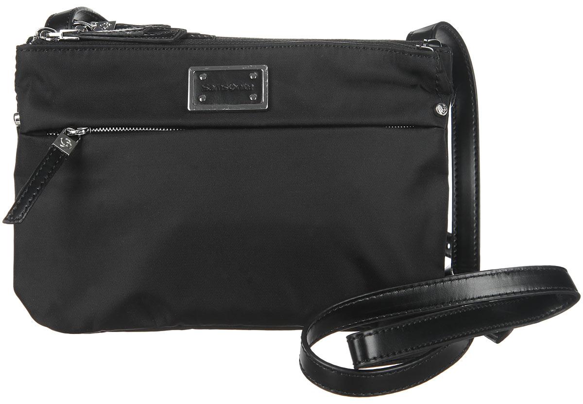 Сумка женская Samsonite, цвет: черный. 22D-0900122D-09001Стильная женская сумка Samsonite выполнена из полиамида и полиуретана, оформлена металлической фурнитурой с символикой бренда. Изделие содержит три отделения, каждое из которых закрывается на застежку-молнию. Внутри сумки расположен врезной карман на застежке-молнии. На лицевой стороне расположен дополнительный кармашек на молнии. Изделие оснащено практичным плечевым ремнем регулируемой длины. Практичный аксессуар позволит вам завершить образ и быть неотразимой.
