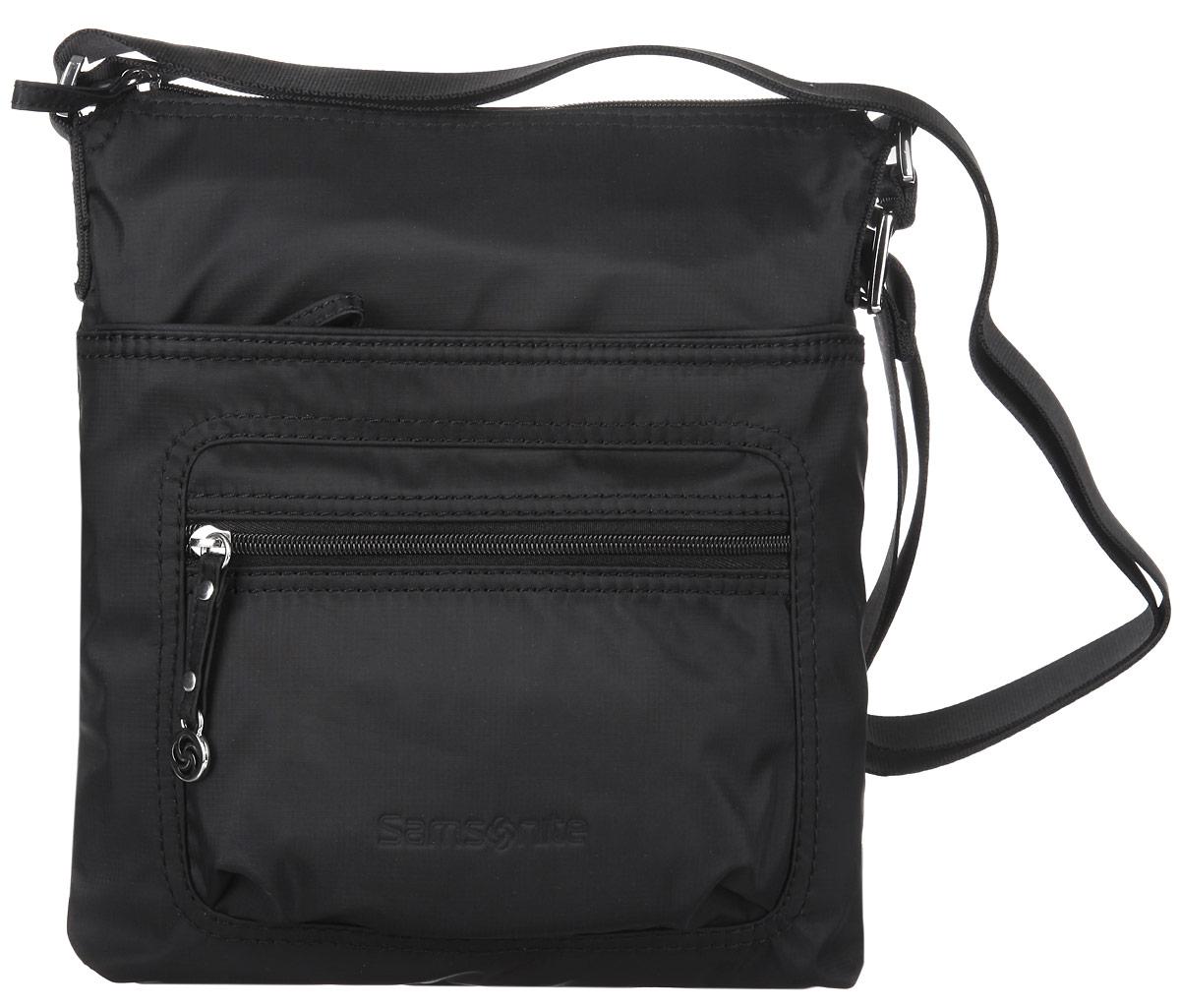 Сумка женская Samsonite, цвет: черный. 5H3-091285H3-09128Стильная женская сумка Samsonite выполнена из полиамида, оформлена металлической фурнитурой и символикой бренда. Изделие содержит одно отделение, закрывающееся на застежку-молнию. Внутри сумки расположены два накладных кармашка для мелочей, врезной карман на застежке-молнии, карабин для ключей и мягкий карман для планшета. На лицевой стороне изделия расположен вместительный накладной карман на молнии и дополнительный кармашек на молнии. Изделие оснащено практичным плечевым ремнем регулируемой длины. Практичный аксессуар позволит вам завершить образ и быть неотразимой.