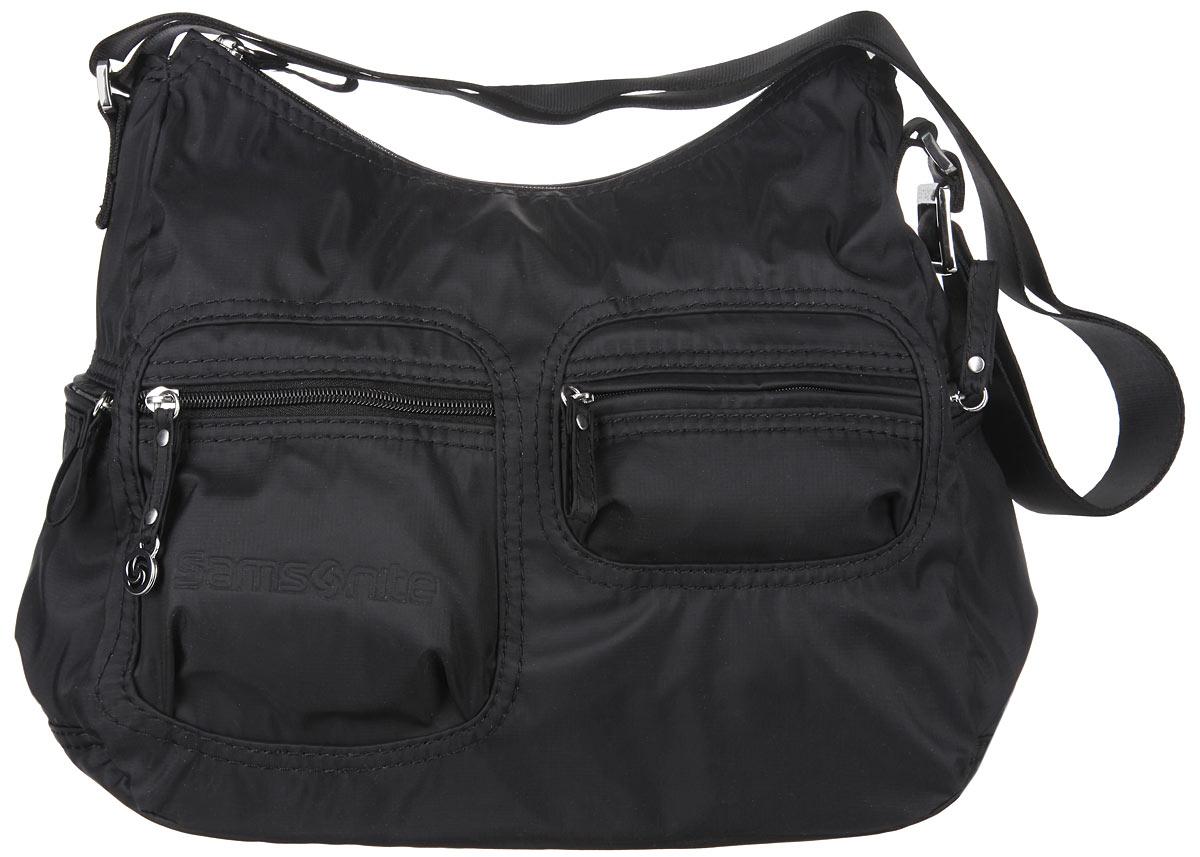Сумка женская Samsonite, цвет: черный. 5H3-090195H3-09019Стильная женская сумка Samsonite выполнена из полиамида, оформлена металлической фурнитурой и символикой бренда. Изделие содержит одно отделение, которое закрывается на застежку-молнию. Внутри сумки расположены два накладных кармашка для мелочей, карабин для ключей и врезной карман на застежке-молнии. На лицевой стороне расположены два врезных кармашка, каждый из которых закрывается на застежку-молнию. Задняя сторона сумки дополнена накладным карманом на застежке-молнии. По бокам сумки расположены два дополнительных кармашка, каждый из которых закрывается на застежку-молнию. Изделие оснащено практичным плечевым ремнем регулируемой длины. Практичный аксессуар позволит вам завершить образ и быть неотразимой.
