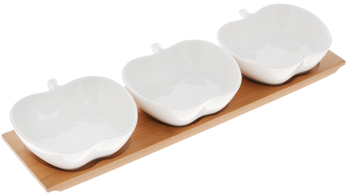 Блюдо сервировочное Elan Gallery Яблоко, на подставке, 120 мл, 3 шт540060Сервировочные блюда Elan Gallery Яблоко изготовлены из высококачественной керамики. Изделия выполнены в виде яблок и идеально подойдет для красивой сервировки различных блюд, таких как икра, конфеты, мед и варенье. В комплекте подставка, выполненная из бамбука. Оригинальные сервировочные блюда станут изысканным украшением вашего праздничного стола. Объем: 120 мл. Размер блюд: 10,8 х 10,7 х 3,5 см. Размер подставки: 33,5 х 8,5 х 1,5 см.