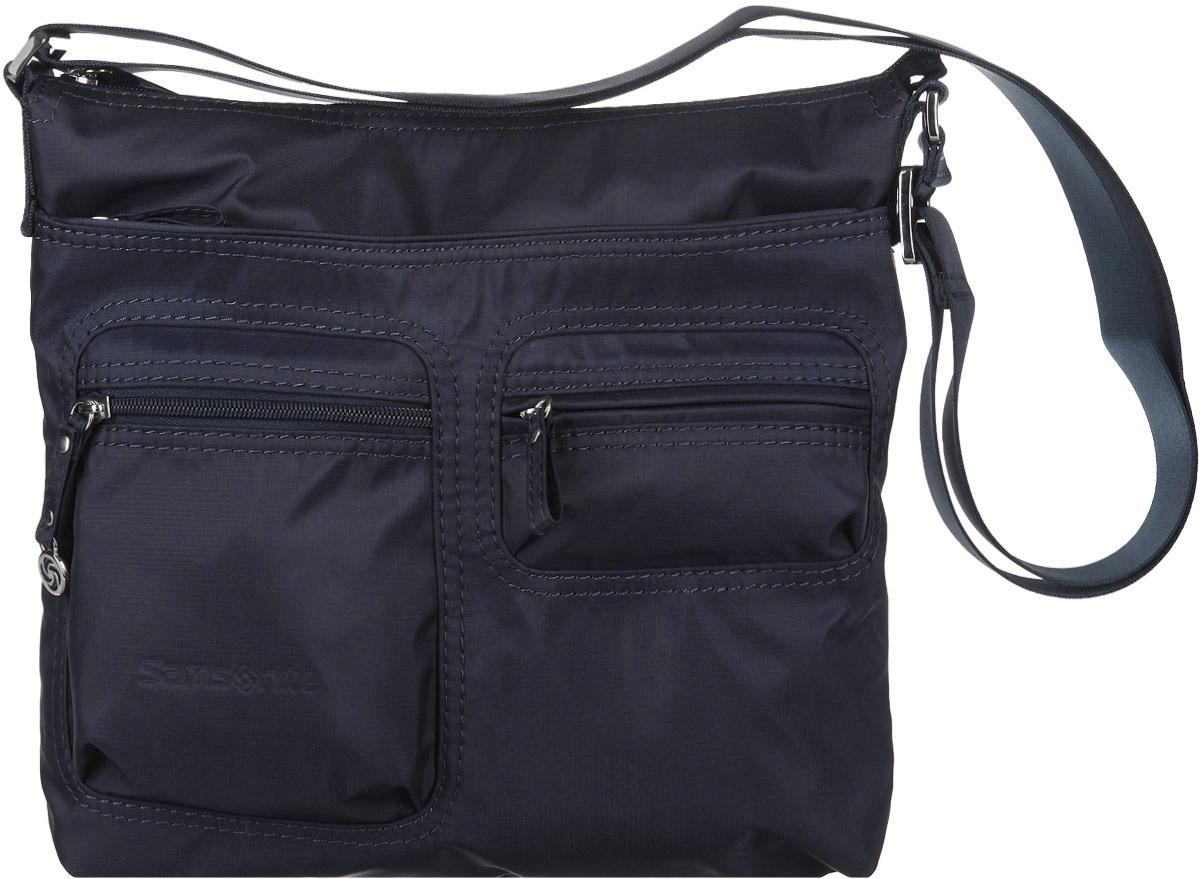 Сумка женская Samsonite, цвет: темно-синий. 5H3-011295H3-01129Стильная женская сумка Samsonite выполнена из полиамида, оформлена металлической фурнитурой и символикой бренда. Изделие содержит одно отделение, которое закрывается на застежку-молнию. Внутри сумки расположены два накладных кармашка для мелочей, карабин для ключей и мягкий карман для планшета. На лицевой стороне сумки расположены два объемных кармашка, каждый из которых закрывается на молнию, и вместительный накладной карман на застежке-молнии. Изделие оснащено практичным плечевым ремнем регулируемой длины. Практичный аксессуар позволит вам завершить образ и быть неотразимой.