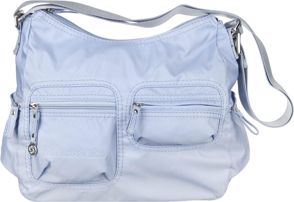 Сумка женская Samsonite, цвет: голубой. 5H3-310195H3-31019Стильная женская сумка Samsonite выполнена из полиамида, оформлена металлической фурнитурой и символикой бренда. Изделие содержит одно отделение, которое закрывается на застежку-молнию. Внутри сумки расположены два накладных кармашка для мелочей, карабин для ключей и врезной карман на застежке-молнии. Задняя сторона сумки дополнена накладным карманом на застежке-молнии. На лицевой стороне сумки расположены два объемных кармашка, каждый из которых закрывается на молнию. По бокам изделия расположены два врезных кармана, закрывающиеся на молнии. Изделие оснащено практичным плечевым ремнем регулируемой длины. Практичный аксессуар позволит вам завершить образ и быть неотразимой.