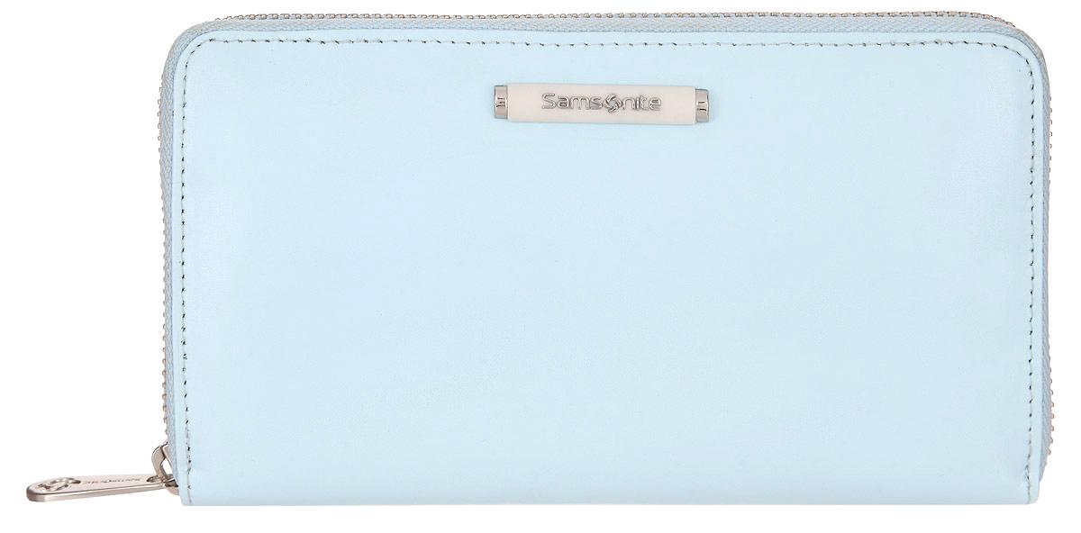 Кошелек женский Samsonite, цвет: голубой. 71V-4131971V-41319Стильный женский кошелек Samsonite выполнен из натуральной кожи, оформлен объемным декоративным элементом с символикой бренда. Внутренняя часть изделия выполнена из полиэстера и натуральной кожи. Изделие закрывается на застежку-молнию. Кошелек содержит четыре отделения для купюр, отделение для монет на молнии, восемь карманов для визиток или кредитных карт и два открытых кармашка для мелких документов. Снаружи, на задней стороне изделия, расположен врезной карман на застежке-молнии. Кошелек станет отличным подарком человеку, ценящему практичные и стильные вещи, а качество его исполнения представит такой подарок в самом выгодном свете.