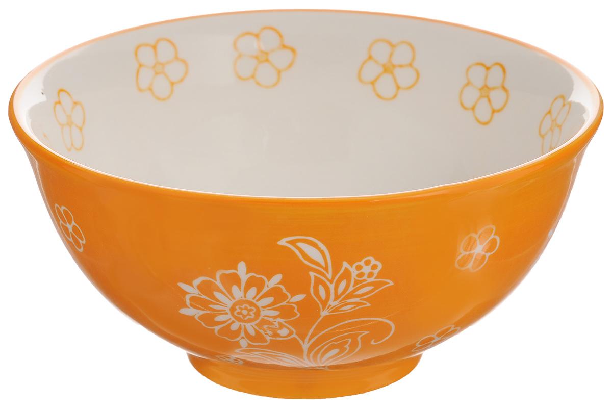 Салатник Elan Gallery Цветочное поле, цвет: оранжевый, белый, 700 мл830046Великолепный круглый салатник Elan Gallery Цветочное поле, изготовленный из высококачественной керамики, прекрасно подойдет для подачи различных блюд: закусок, салатов или фруктов. Такой салатник украсит ваш праздничный или обеденный стол, а оригинальное исполнение понравится любой хозяйке. Не рекомендуется применять абразивные моющие средства. Не использовать в микроволновой печи. Диаметр салатника (по верхнему краю): 15,5 см.