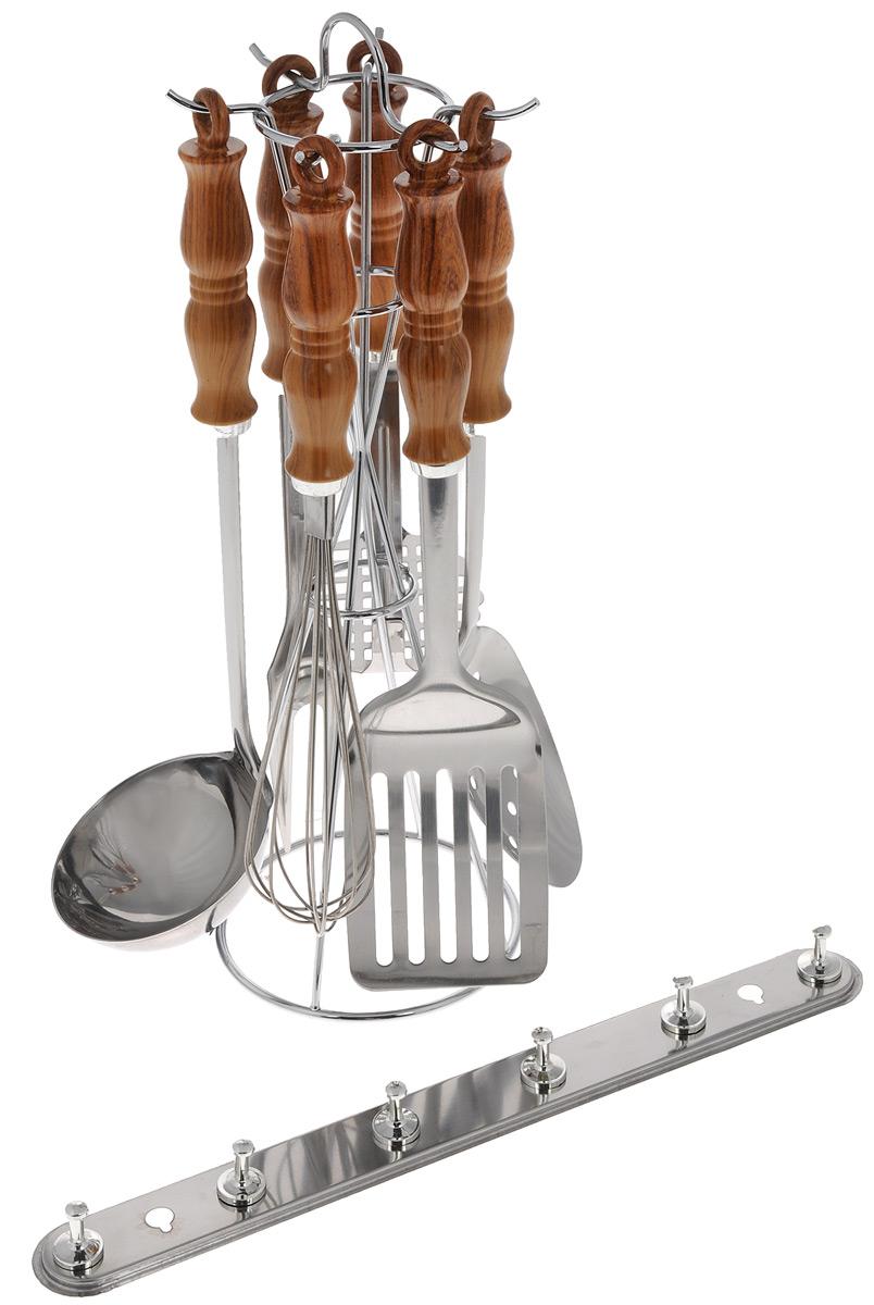 Набор кухонных принадлежностей Mayer & Boch, 8 предметов. 34453445Набор Mayer & Boch состоит из картофелемялки, венчика, шумовки, вилки, половника, лопатки с прорезями, настенного крепления и подставки. Приборы изготовлены из высококачественной нержавеющей стали. Приборы не окисляются со временем и не портят вкус ваших кулинарных шедевров. Рукоятки выполнены из термопластика под дерево. Данный набор придаст вашей кухне элегантность, подчеркнет индивидуальный дизайн и превратит приготовление еды в настоящее удовольствие. Этот профессиональный набор очень удобен в использовании и имеет стильную подставку, декорированную под дерево, которая позволяет хранить приборы в одном месте. Длина приборов: 24-34 см. Размер настенного крепления: 33 х 2,5 х 3,5 см. Размер подставки: 13 х 13 х 37 см.