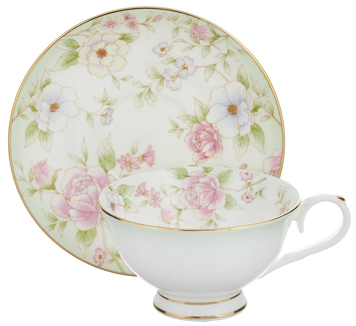 Чайная пара Elan Gallery Карнавал цветов, 2 предмета530039Чайная пара Elan Gallery Карнавал цветов состоит из чашки и блюдца, изготовленных из керамики высшего качества, отличающегося необыкновенной прочностью и небольшим весом. Яркий дизайн, несомненно, придется вам по вкусу. Чайная пара Elan Gallery Карнавал цветов украсит ваш кухонный стол, а также станет замечательным подарком к любому празднику. Не рекомендуется применять абразивные моющие средства. Не использовать в микроволновой печи. Объем чашки: 230 мл. Диаметр чашки (по верхнему краю): 10,5 см. Высота чашки: 6,5 см. Диаметр блюдца: 15 см. Высота блюдца: 2 см.