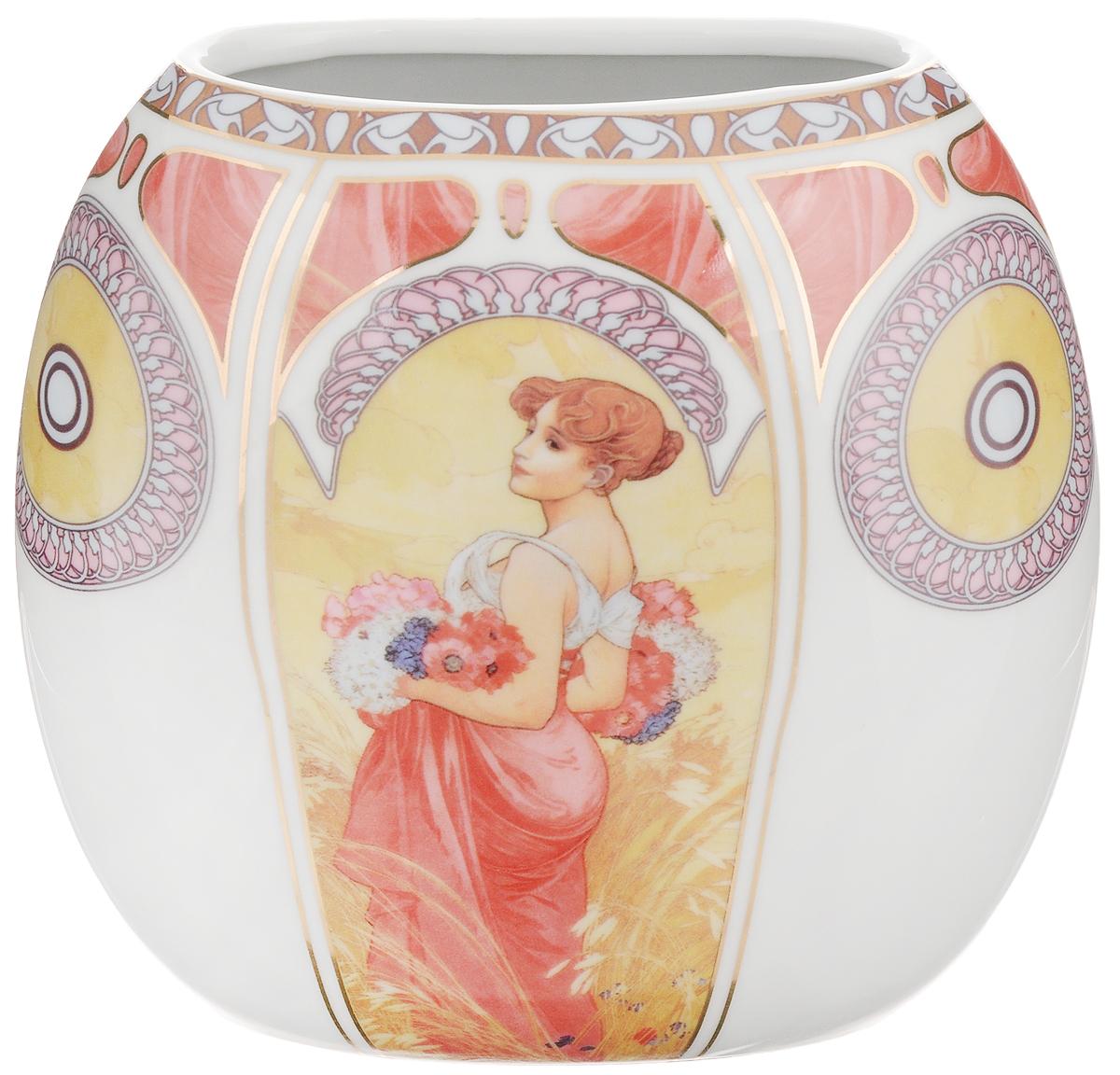 Ваза Elan Gallery Лето, высота 15 см503950Декоративная ваза Elan Gallery Лето украсит ваш интерьер и будет прекрасным подарком для ваших близких! Она подойдет для небольших букетиков цветов или сухоцветов. Изделие выполнено из высококачественного фарфора и украшено ярким рисунком. Оригинальный дизайн наполнит ваш дом праздничным настроением. Такая ваза станет желанным подарком для ваших близких! Размер вазы по верхнему краю: 11 х 5,5 см. Размер дна: 11 х 5,5 см. Высота вазы: 15 см.
